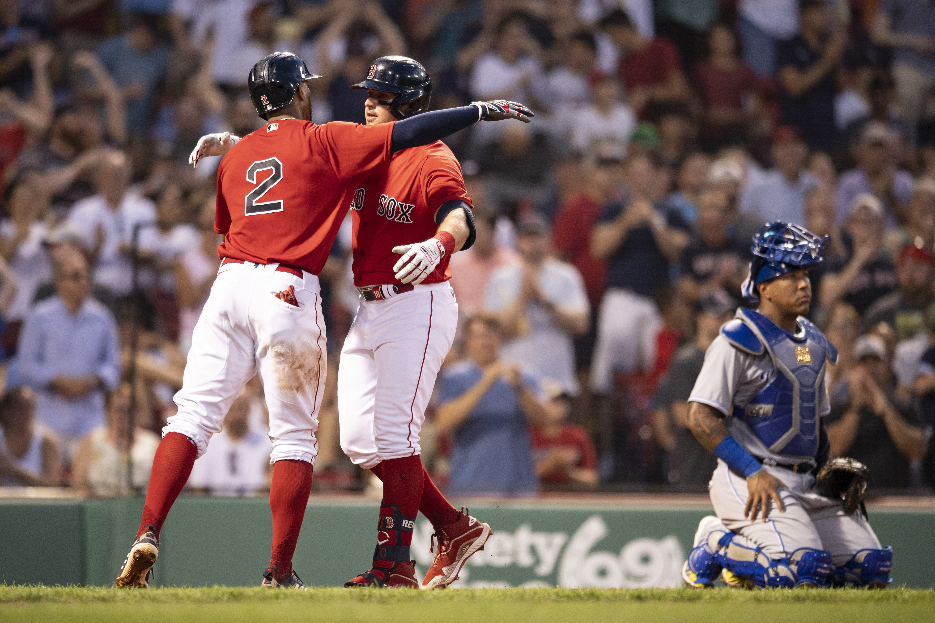 Hunter Renfroe #10 of the Boston Red Sox reacts with Xander Bogaerts #2 after hitting a two-run home run during the fourth inning of a game against the Kansas City Royals on June 28, 2021 at Fenway Park in Boston, Massachusetts.