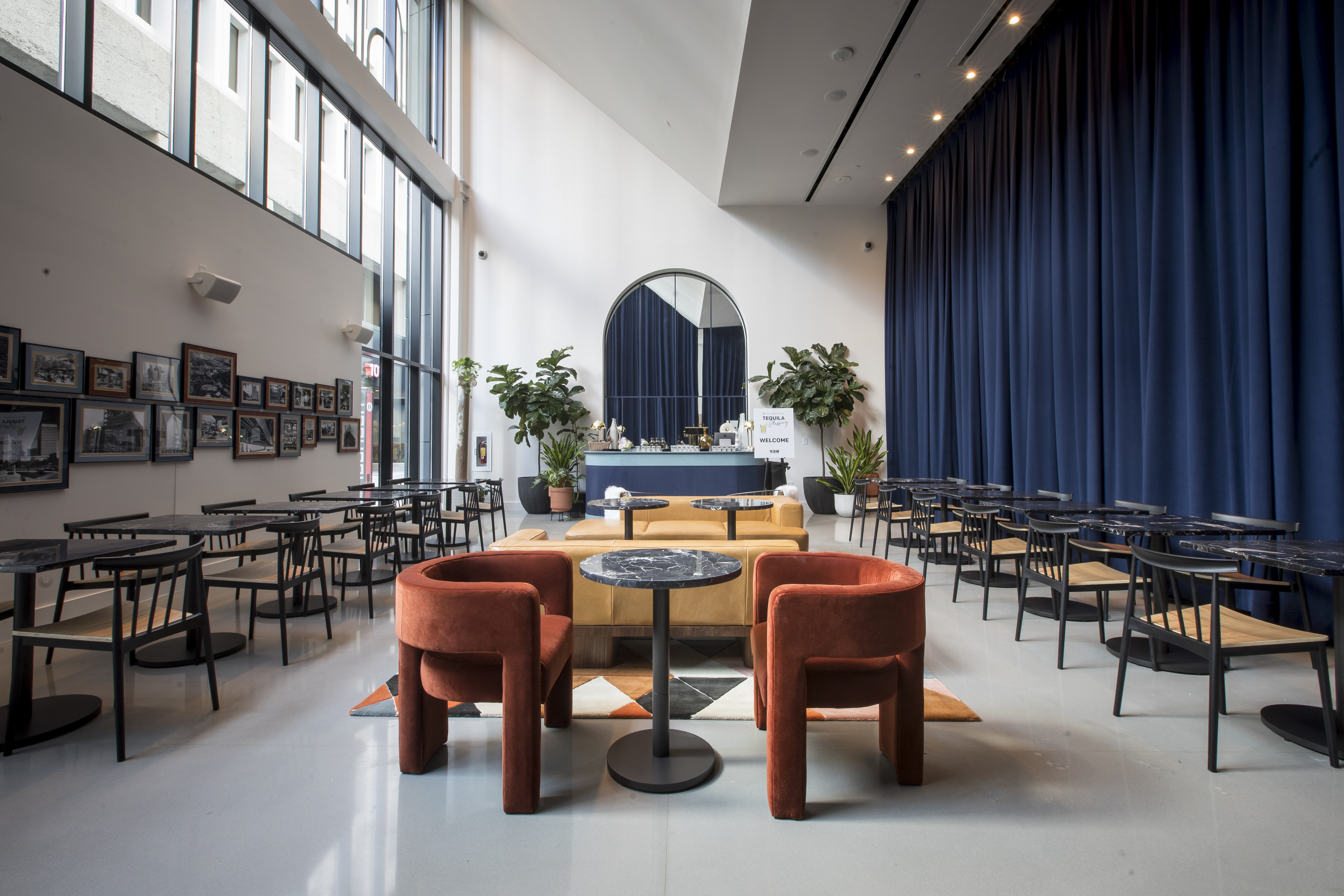Politan Row food hall dining area with three rows of mid-century modern tables and chairs