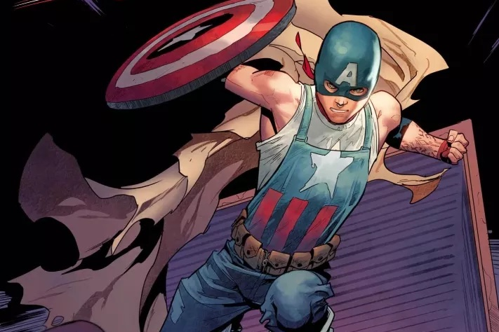 Aaron Fischer, a homeless queer kid who keeps his peers safe while wearing the colors of Captain America, leaps through the air with his trash can shield in United States of Captain America #1 (2021).