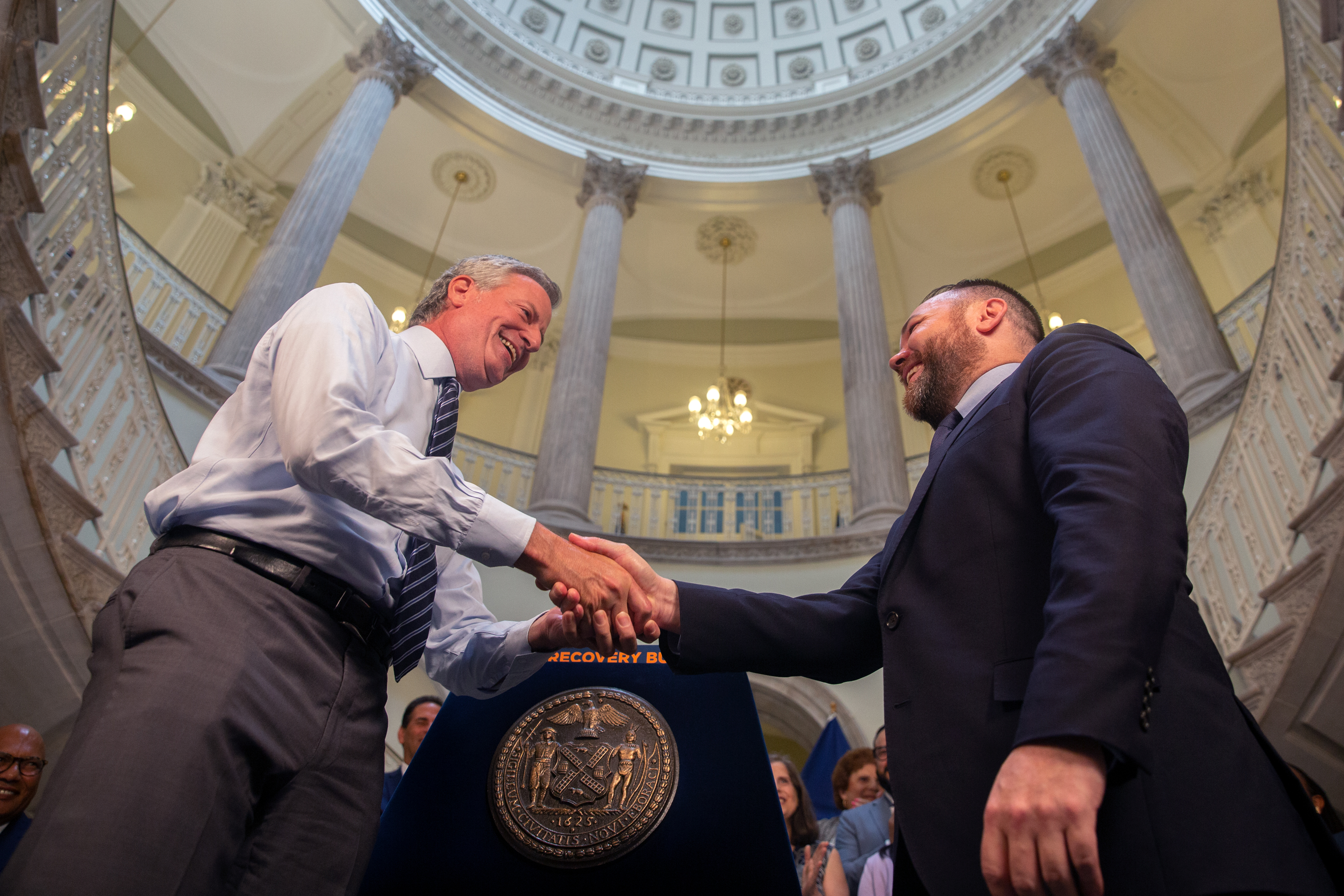 Mayor Bill de Blasio and Council Speaker Corey Johnson shake hands at City Hall on a budget deal, June 30, 2021.