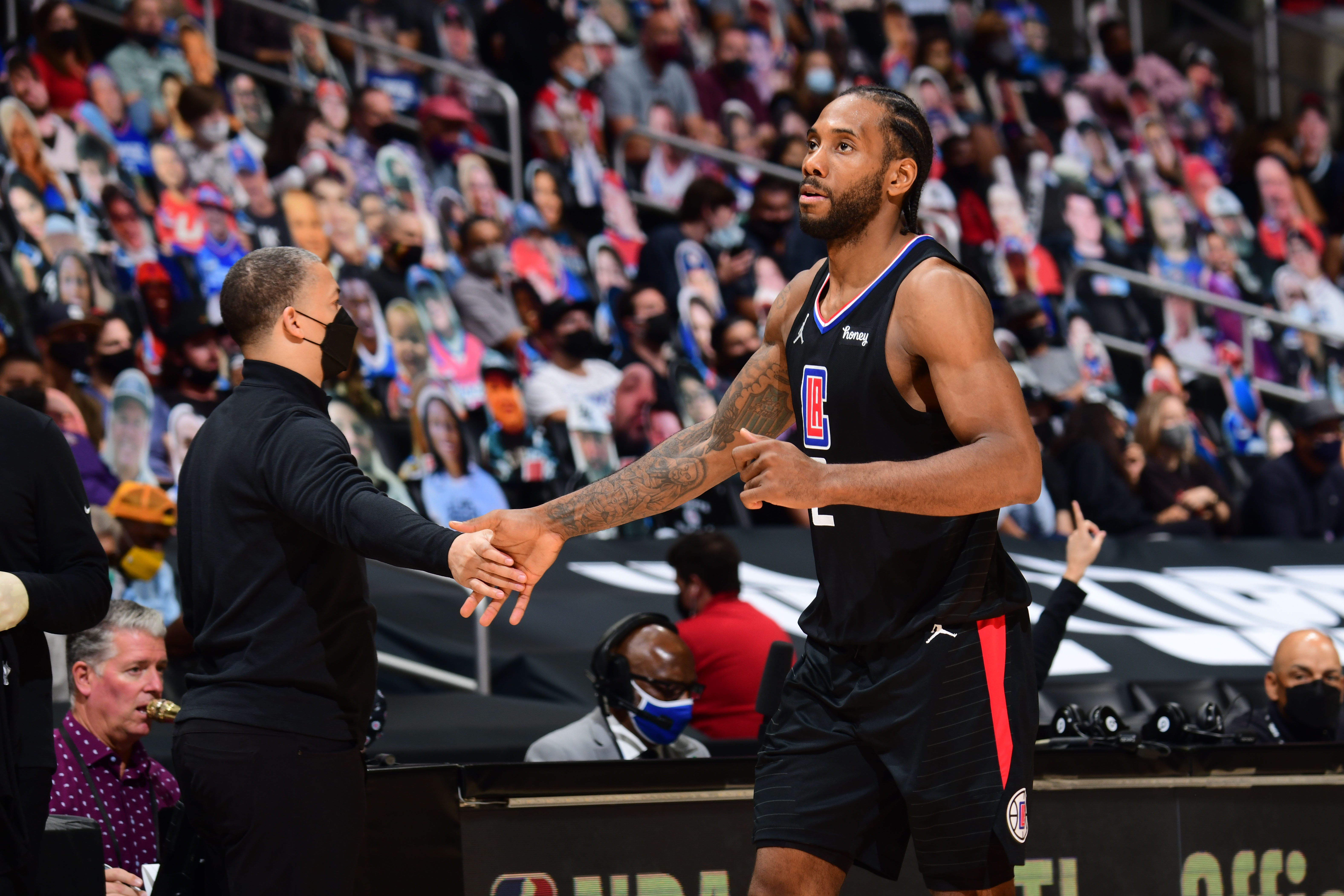 Head Coach Tyronn Lue of the Los Angeles Clippers hi-fives Kawhi Leonard #2 during Round 2, Game 4 of 2021 NBA Playoffs on June 14, 2021 at STAPLES Center in Los Angeles, California.