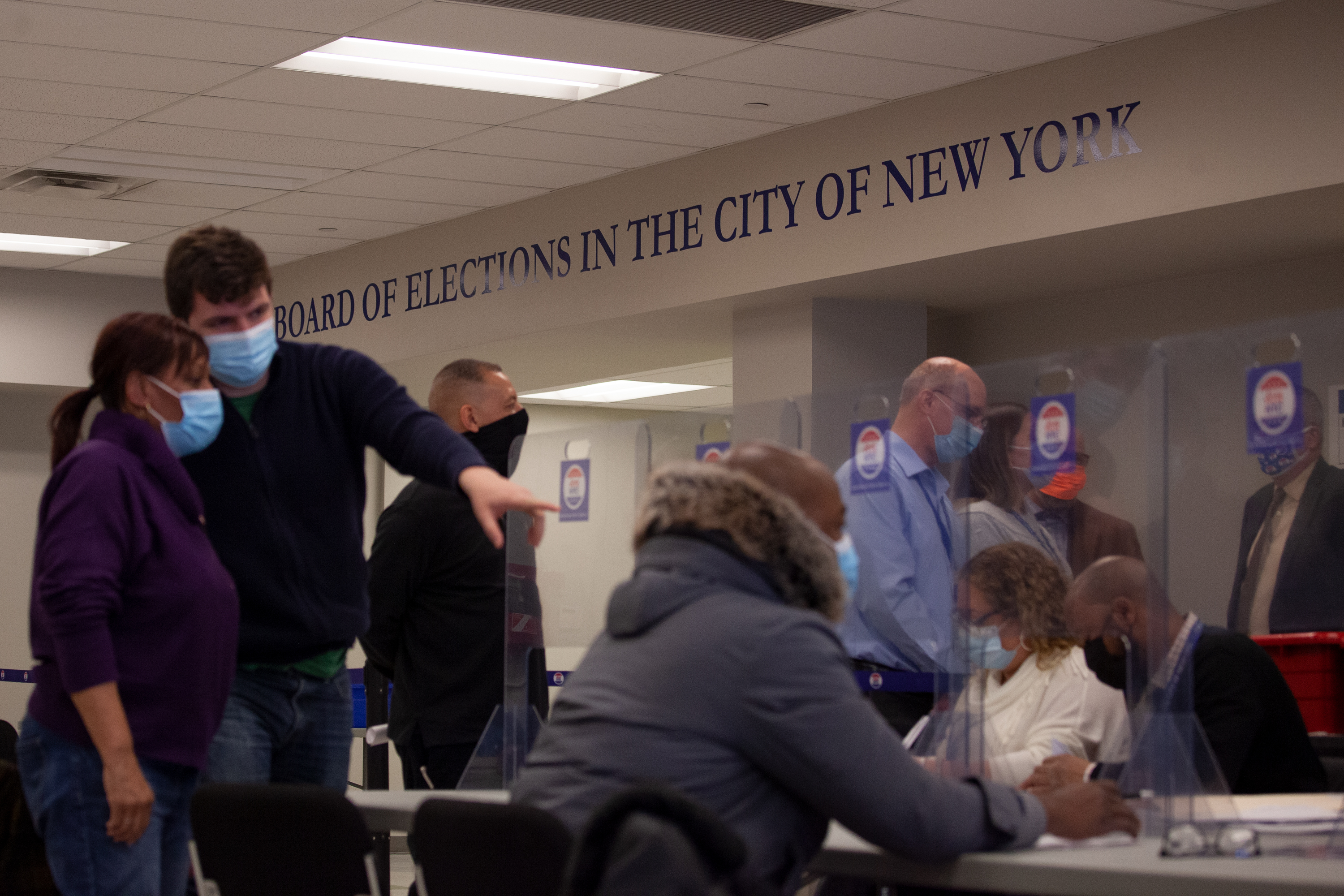 Board of Elections workers help tally the first round of ranked choice ballots in the Queens City Council District 31 race, March 16, 2021.