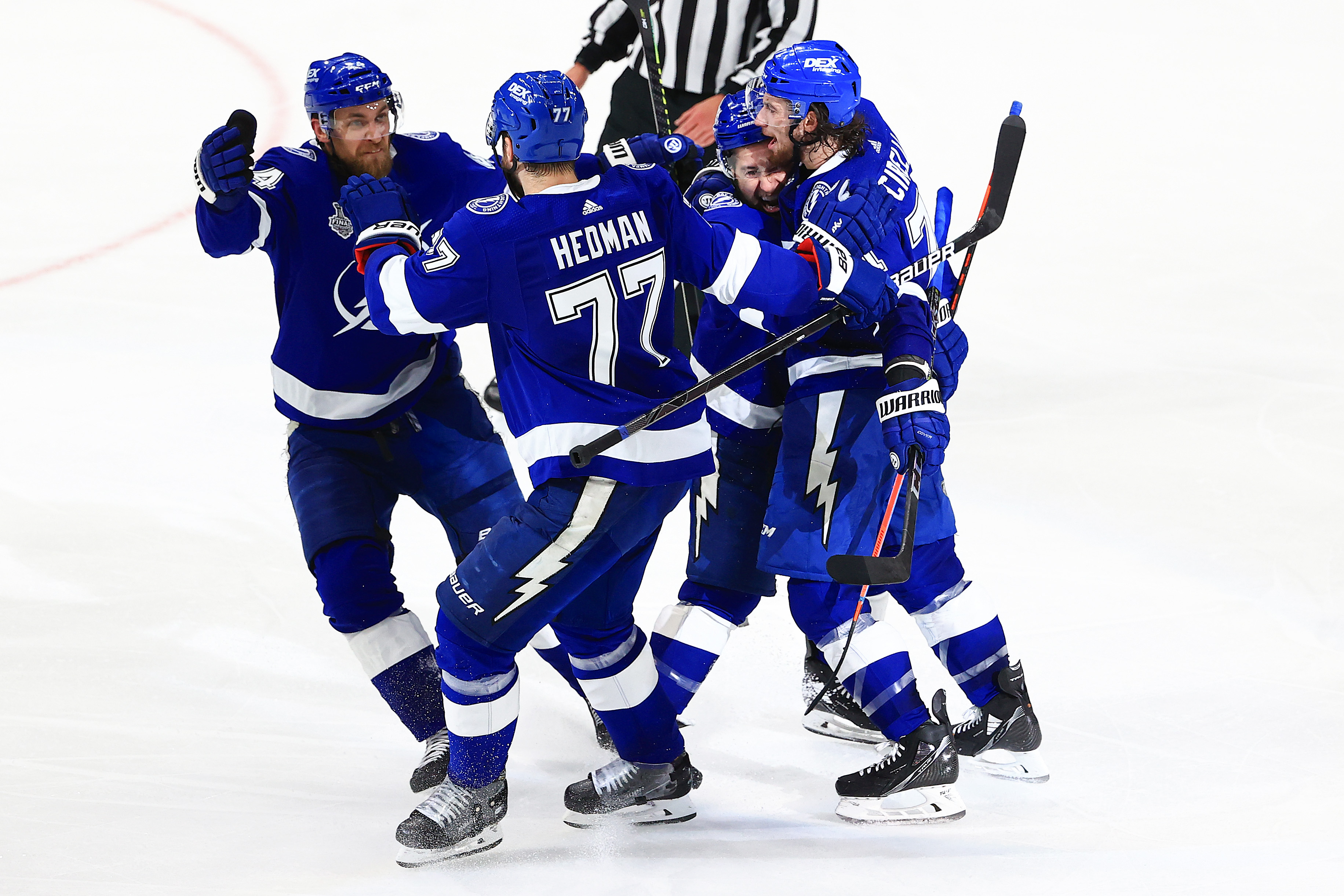 Anthony Cirelli #71 of the Tampa Bay Lightning celebrates with teammates Tyler Johnson #9, Victor Hedman #77, and Jan Rutta #44 after scoring against Carey Price #31 of the Montreal Canadiens during the second period in Game Two of the 2021 NHL Stanley Cup Final at Amalie Arena on June 30, 2021 in Tampa, Florida.