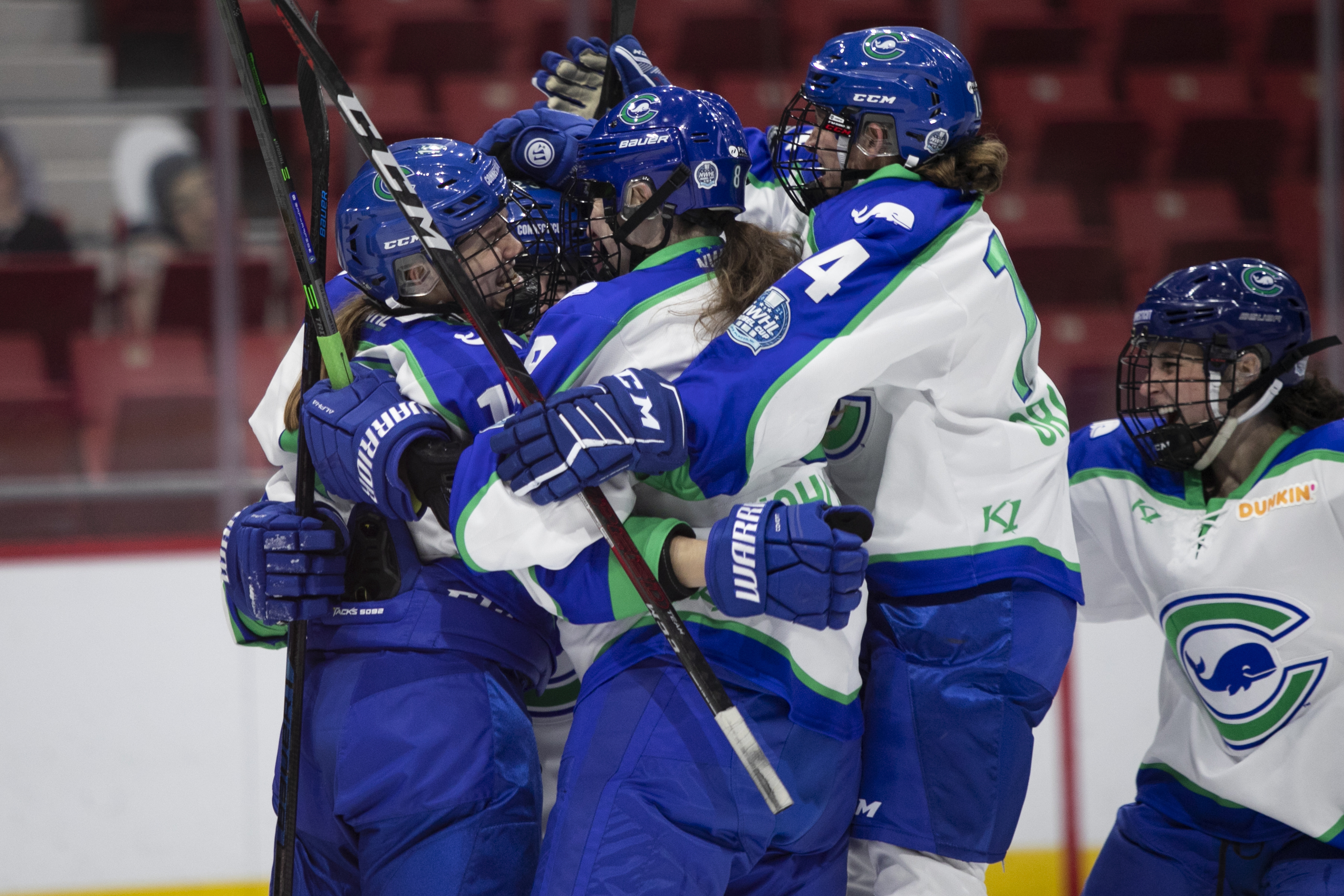 Connecticut Whale celebrate a goal in Lake Placid, NY.