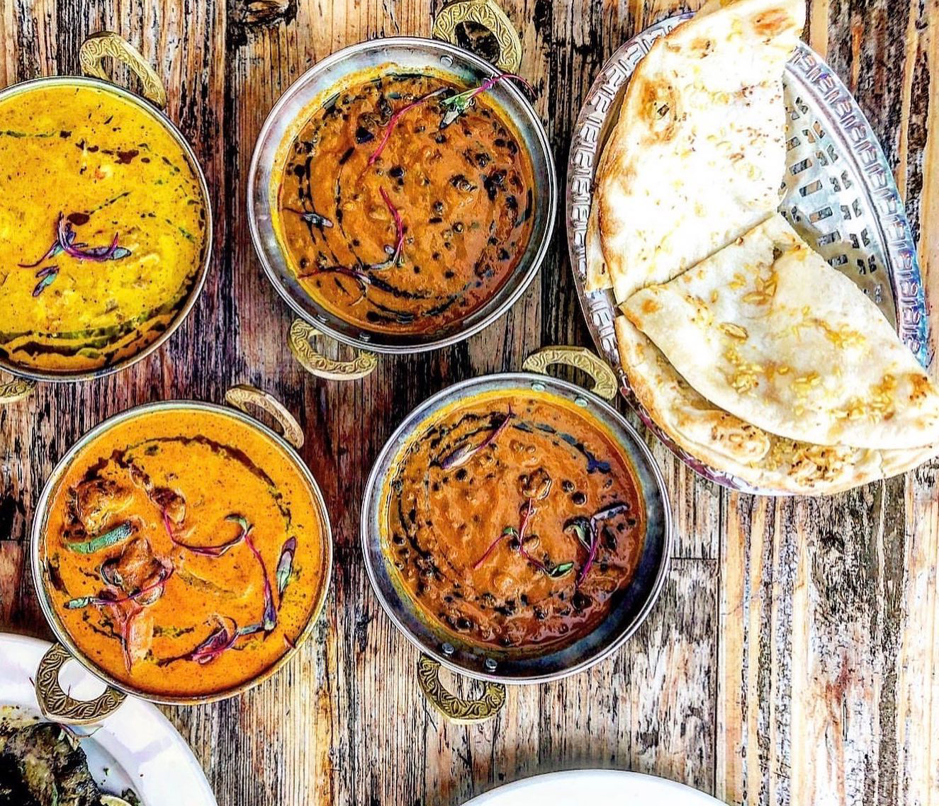 Curries and naan from G'Raj Mahal