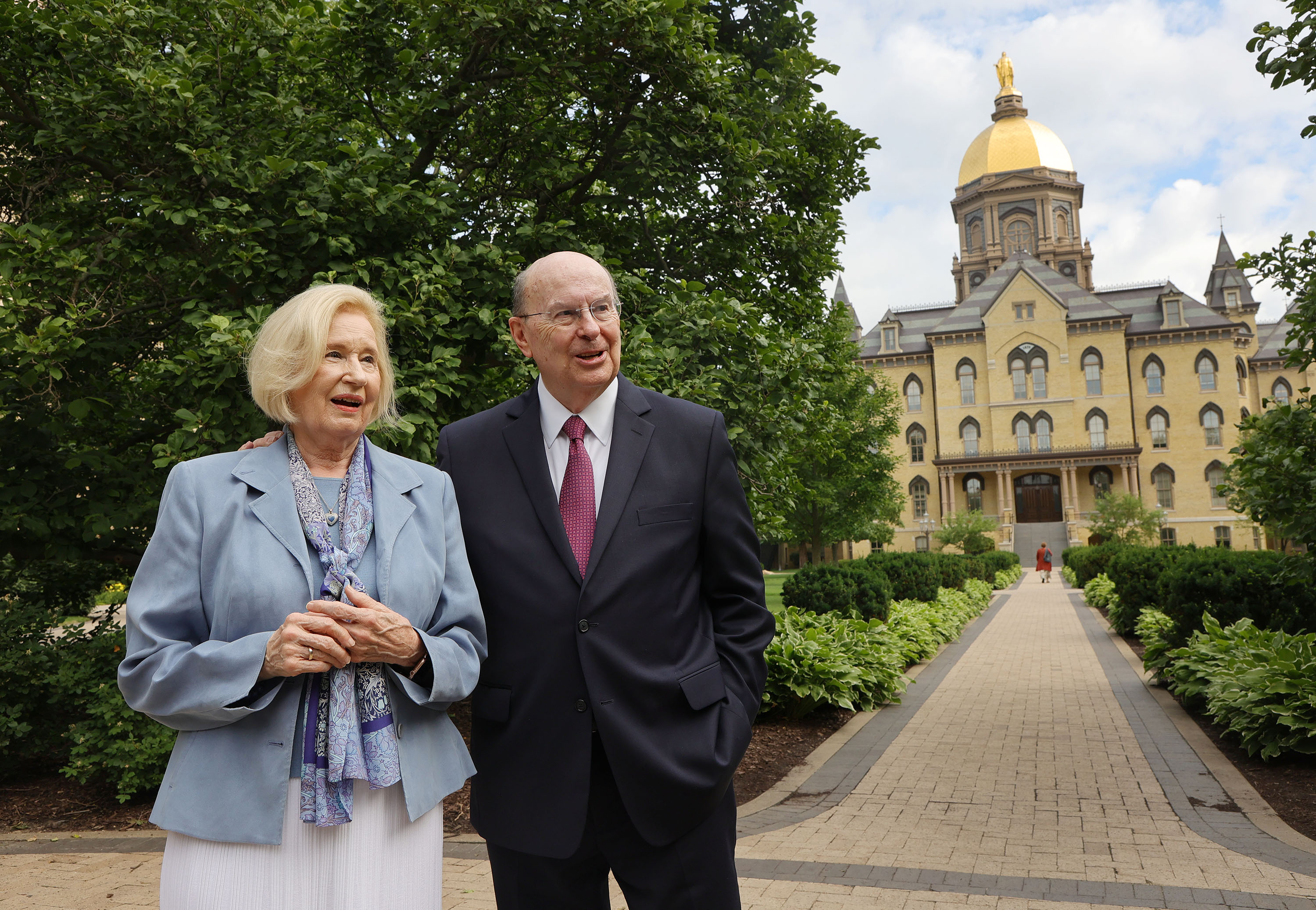 Sister Mary Cook and husband Elder Quentin L. Cook, a member of the Quorum of the Twelve Apostles of The Church of Jesus Christ of Latter-day Saints, walk near the Notre Dame Golden Dome during the Notre Dame Religious Liberty Summit at the University of Notre Dame in South Bend, Ind., on Monday, June 28, 2021. The annual gathering involves thought leaders of religious liberty.