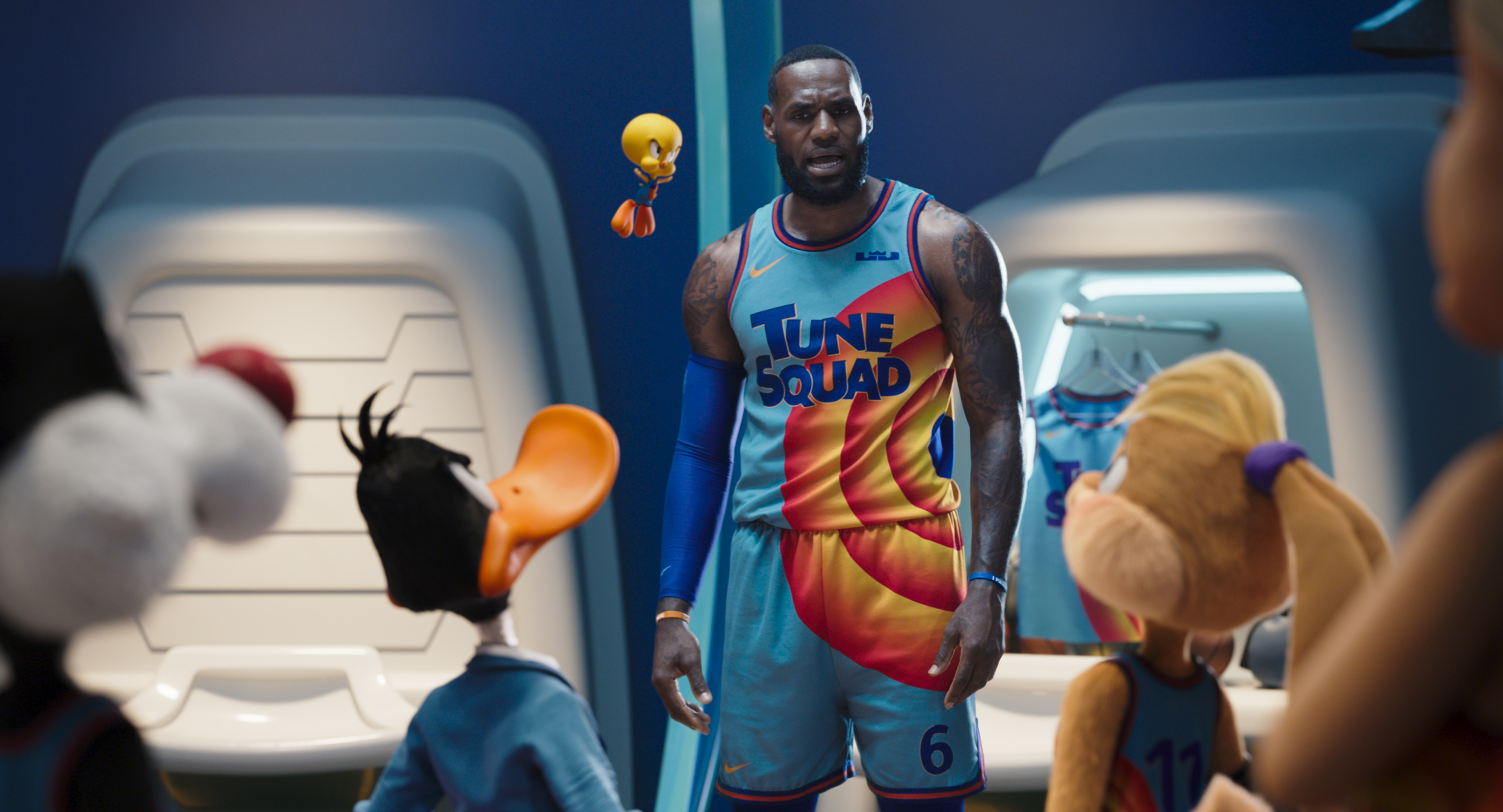 NBA star LeBron James is surrounded by Looney Tunes characters.