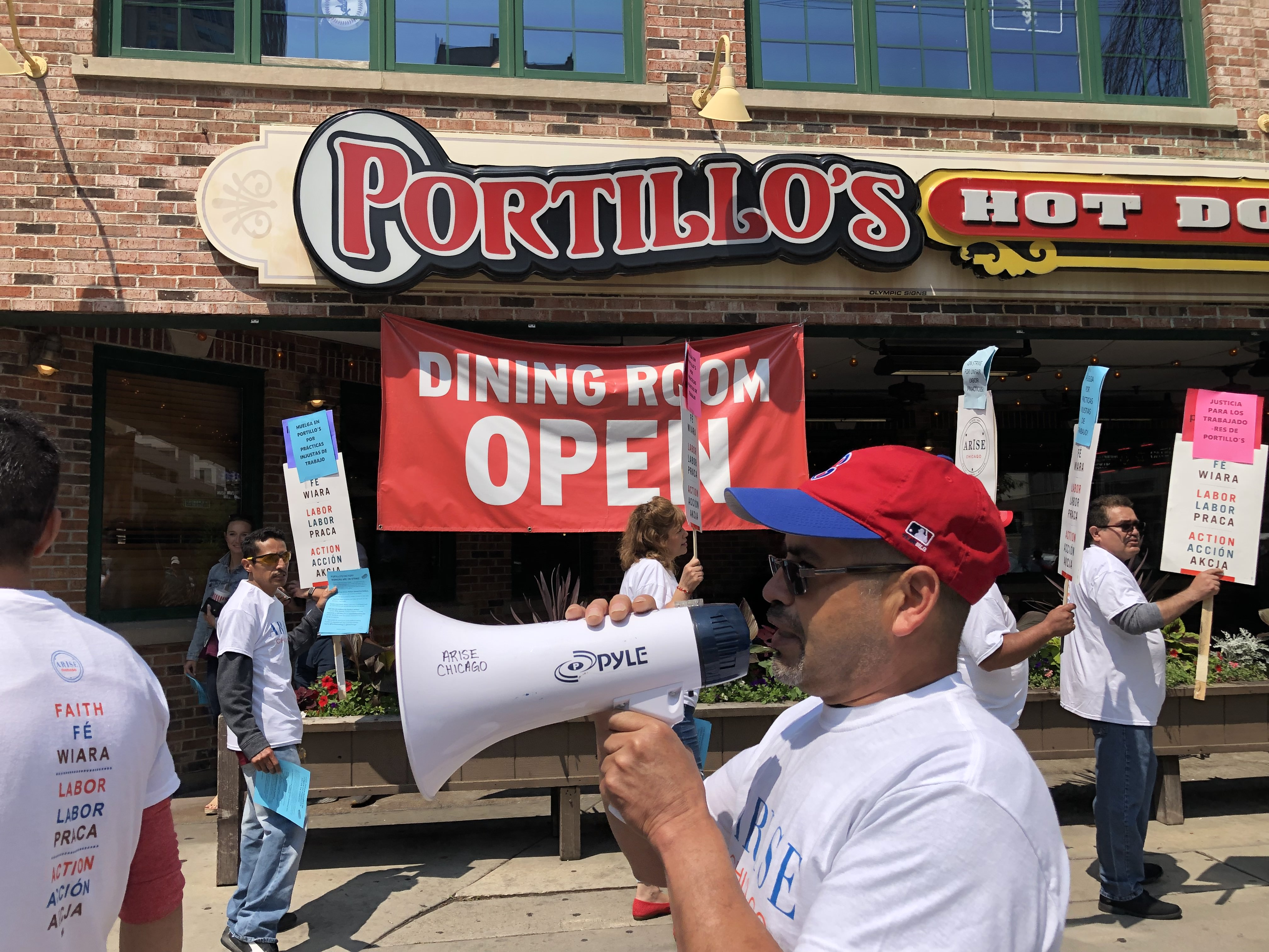 Workers for Portillo's Food Group hold a walkout in front of the chain-restaurants flagship location in River North.