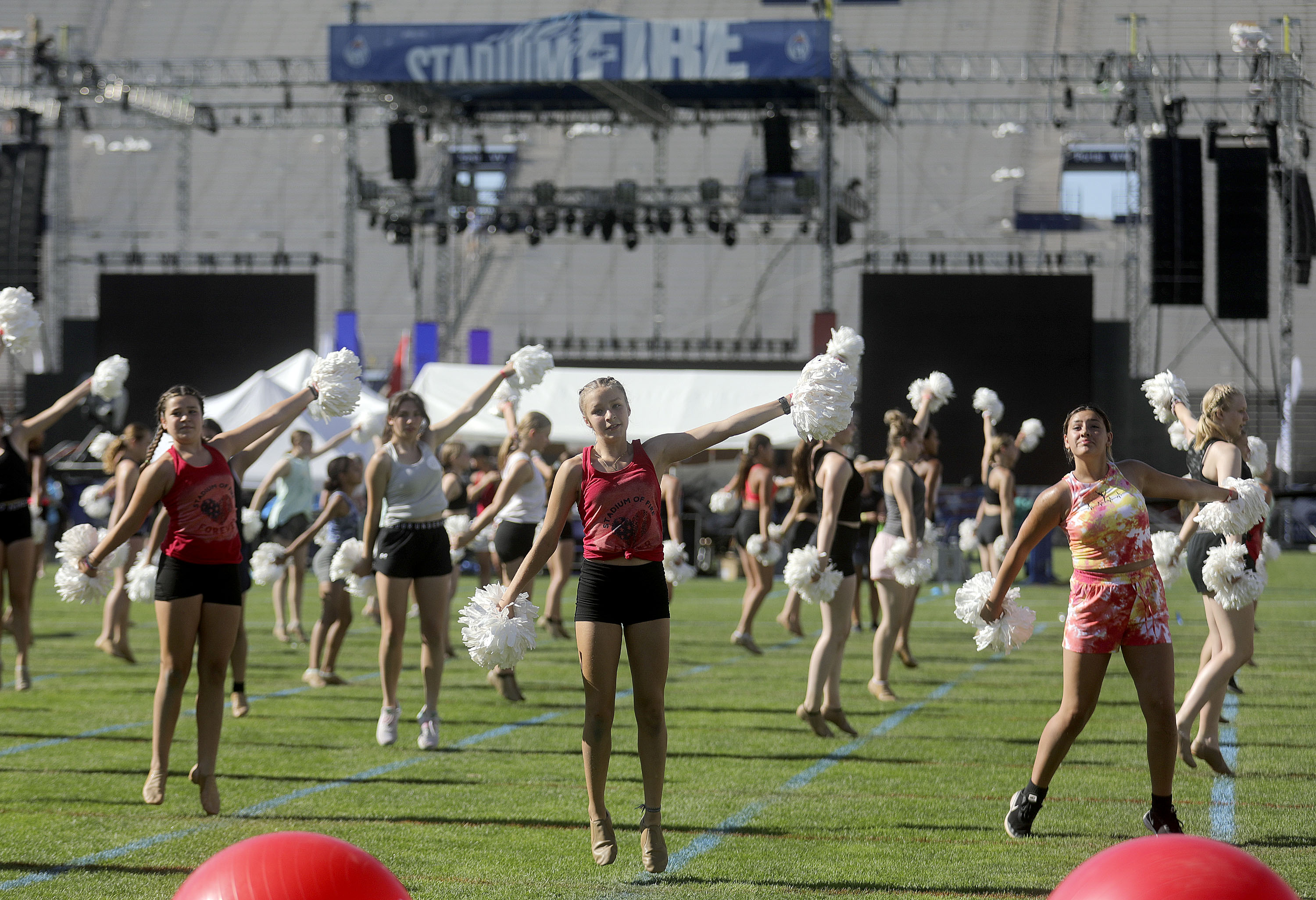 Stadium of Fire dancers practice at Provo's LaVell Edwards Stadium in summer 2021.