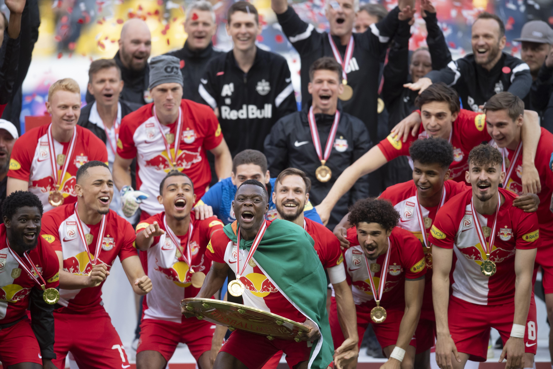 Patson Daka celebrates with the 2020-21 Austrian Soccer Championship trophy - Red Bull Salzburg - tipico Bundesliga