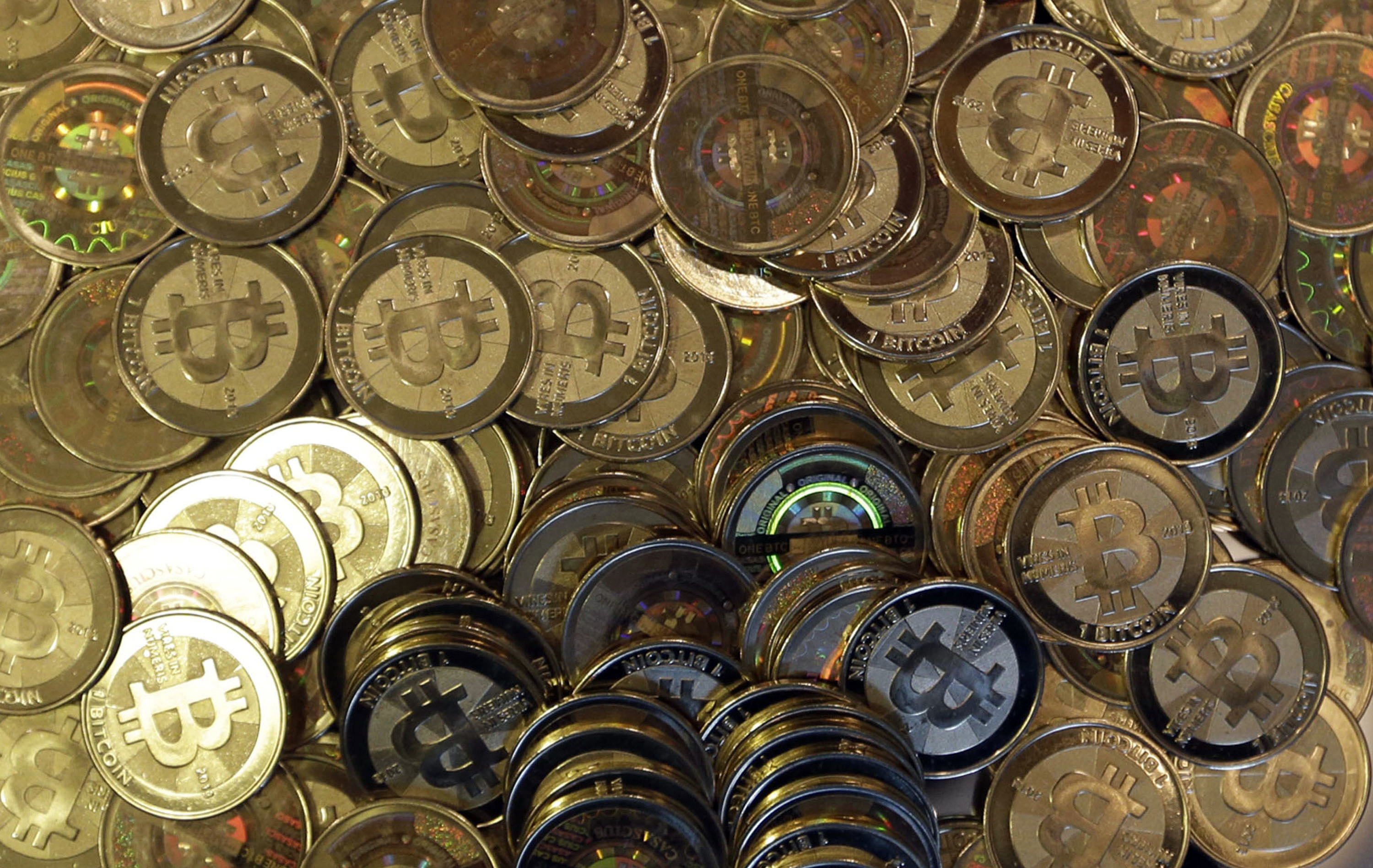 Pile of physical Bitcoins, known as Casascius coins, which were created by Mike Caldwell in Sandy, Utah.
