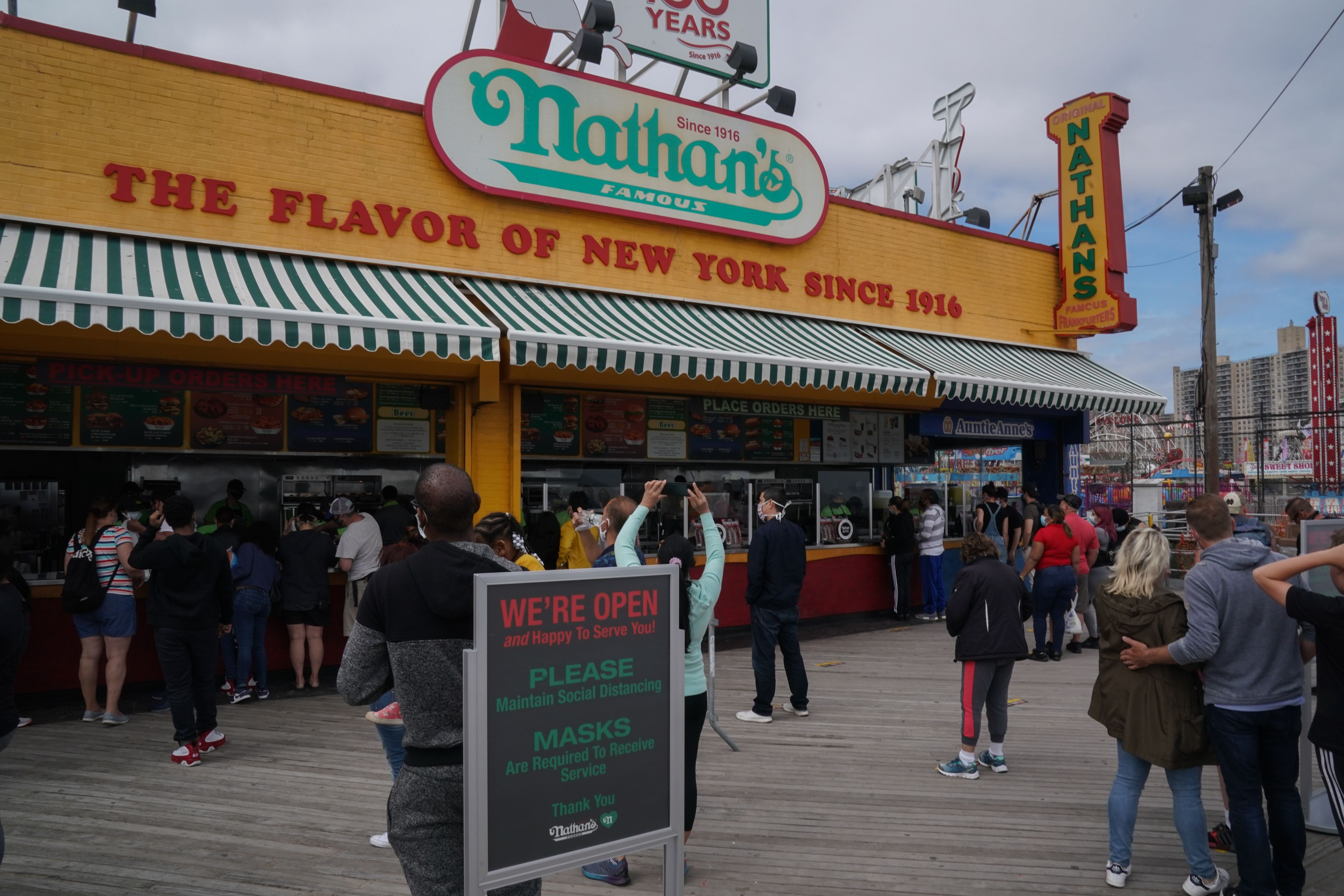 Nathan's Famous hotdog stand is open on the boardwalk at Coney Island.