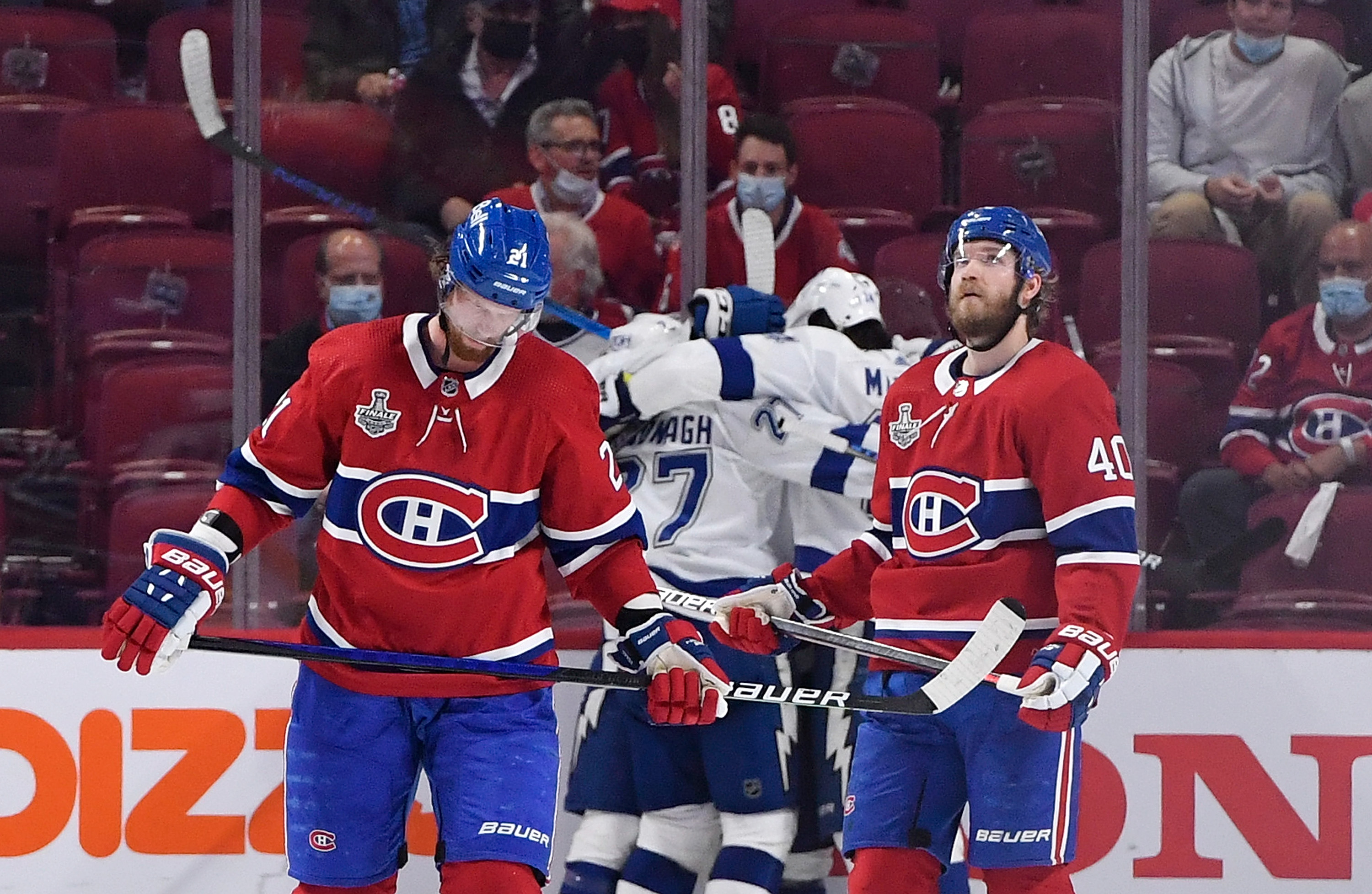 Tampa Bay Lightning center Tyler Johnson (9) is congratulated by teammates after scoring his second goal of the game as Montreal Canadiens center Eric Staal (21) and right wing Joel Armia (40) look on during the third period in game three of the 2021 Stanley Cup Final at the Bell Centre.
