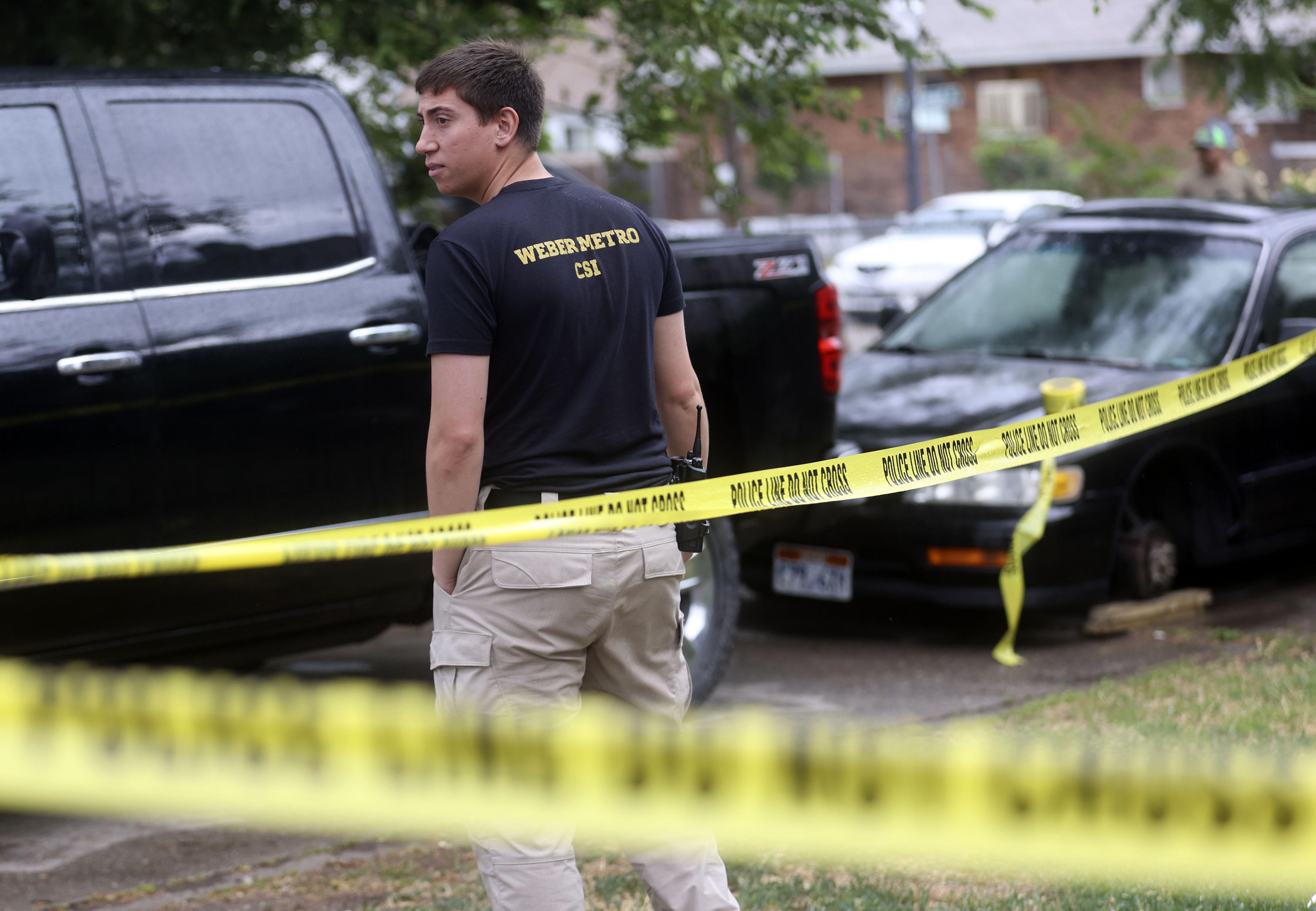 Weber Metro crime scene investigators works at the scene of a shooting on Monroe Boulevard in Ogden.