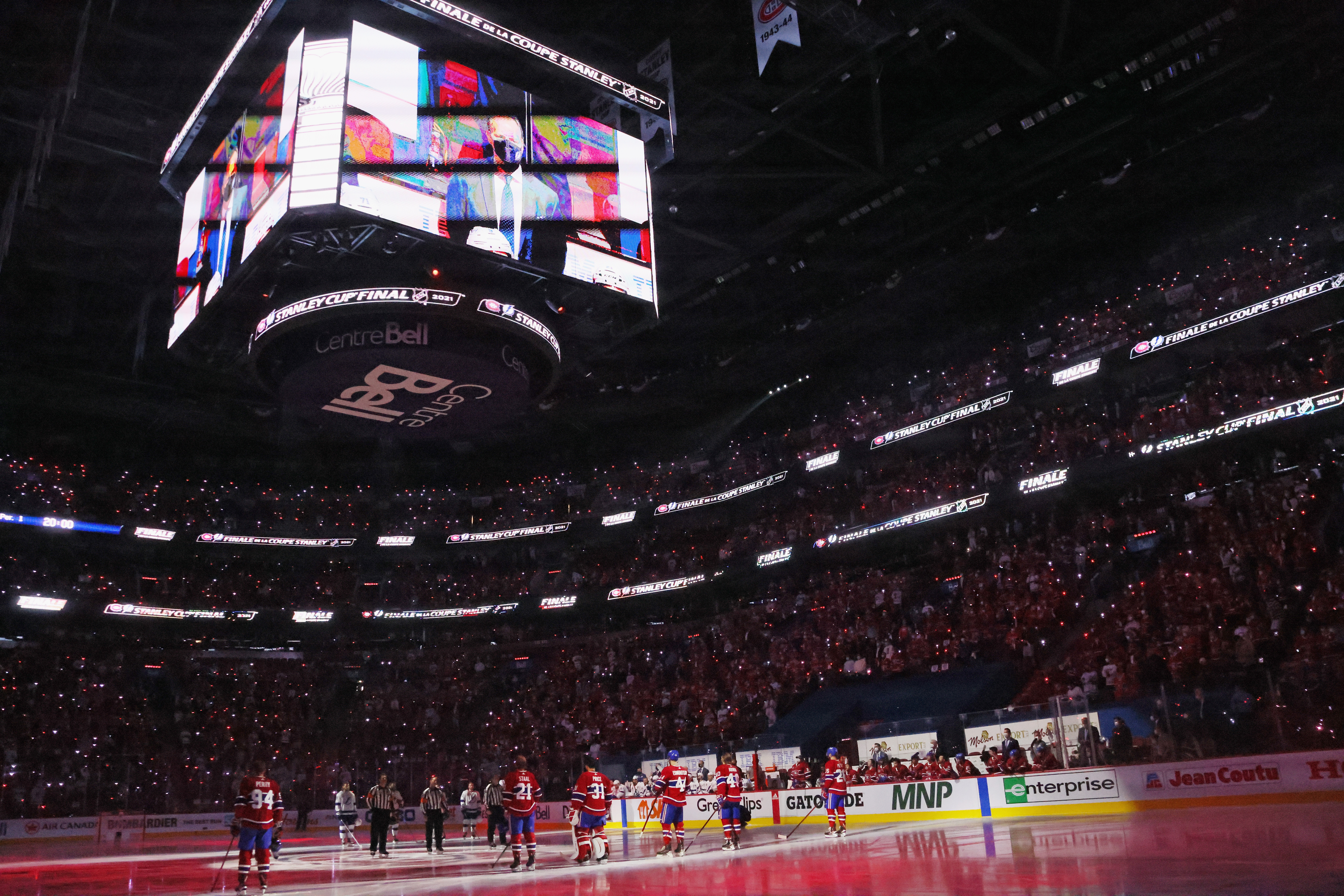 The Tampa Bay Lightning and the Montreal Canadiens stand at attention prior to Game Three of the 2021 NHL Stanley Cup Final at the Bell Centre on July 02, 2021 in Montreal, Quebec, Canada. The Lightning defeated the Canadiens 6-3.