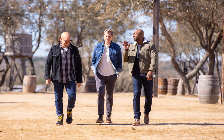 """Captains Michael Symon (from left) Bobby Flay, and Eddie Jackson chat as they approach the contenders, as seen on Season 2 of """"BBQ Brawl."""""""