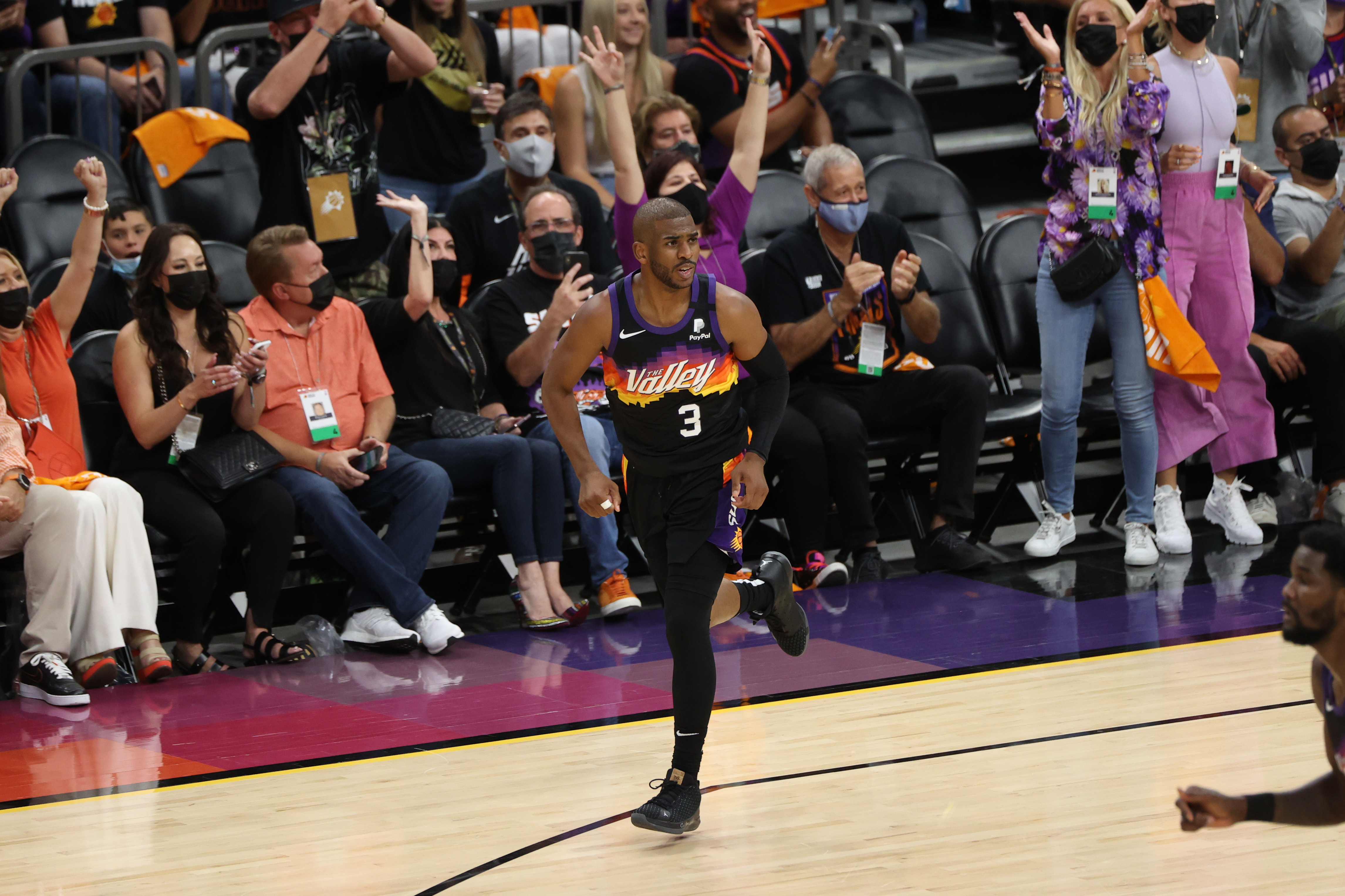 Chris Paul #3 of the Phoenix Suns celebrates during Game One of the 2021 NBA Finals on July 6, 2021 at Phoenix Suns Arena in Phoenix, Arizona.