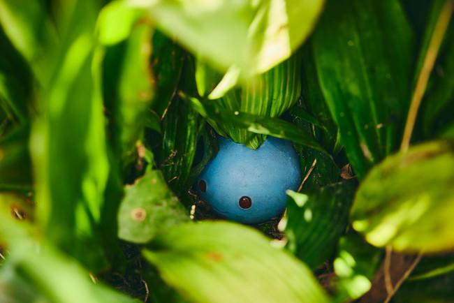 a realistic little oddish hiding in a bush