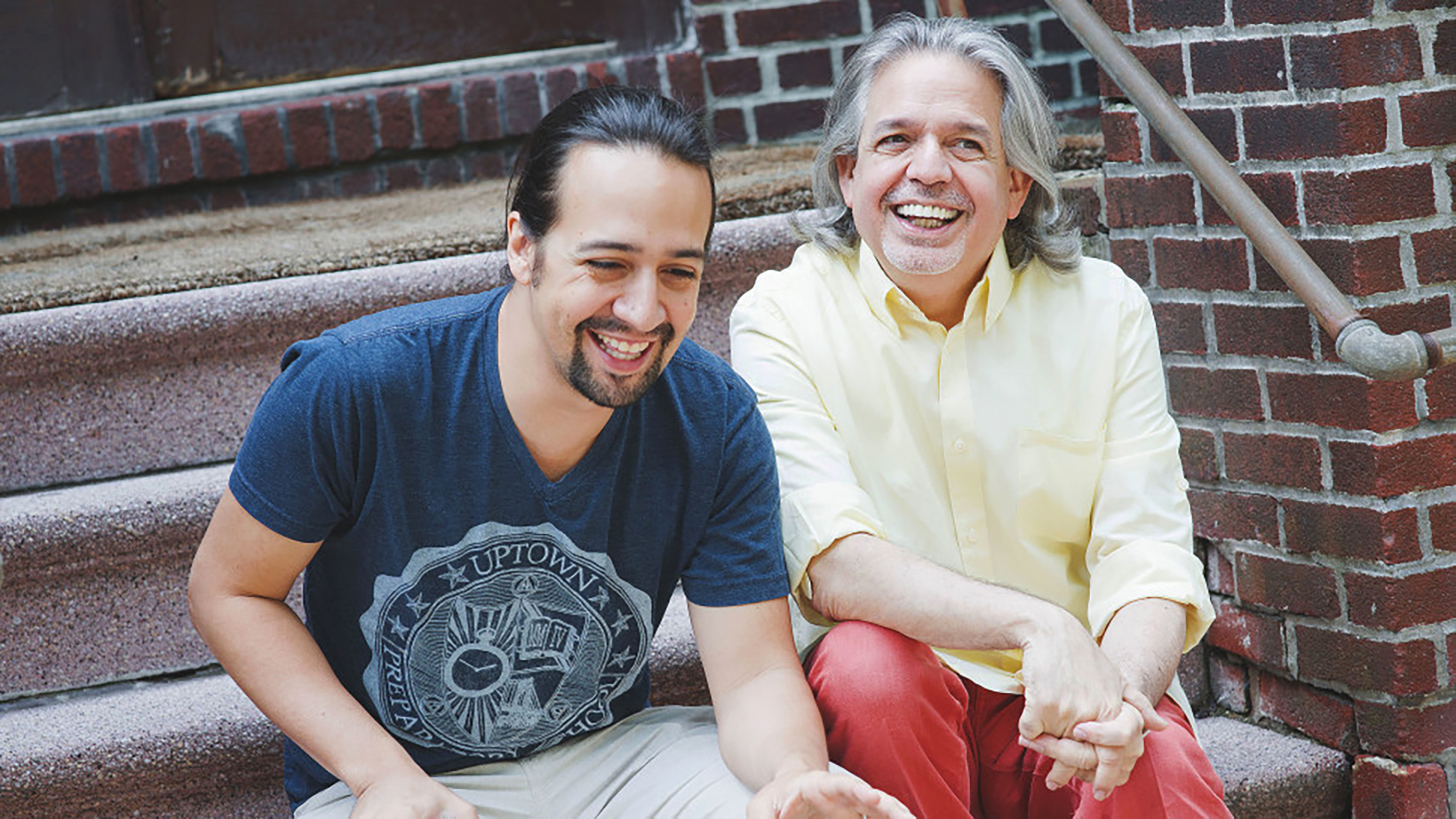 """Lin-Manuel Miranda (left) laughs with his father Luis Miranda Jr. The award-winning """"Hamilton"""" creator says the inspirations for his art and philanthropy are linked."""