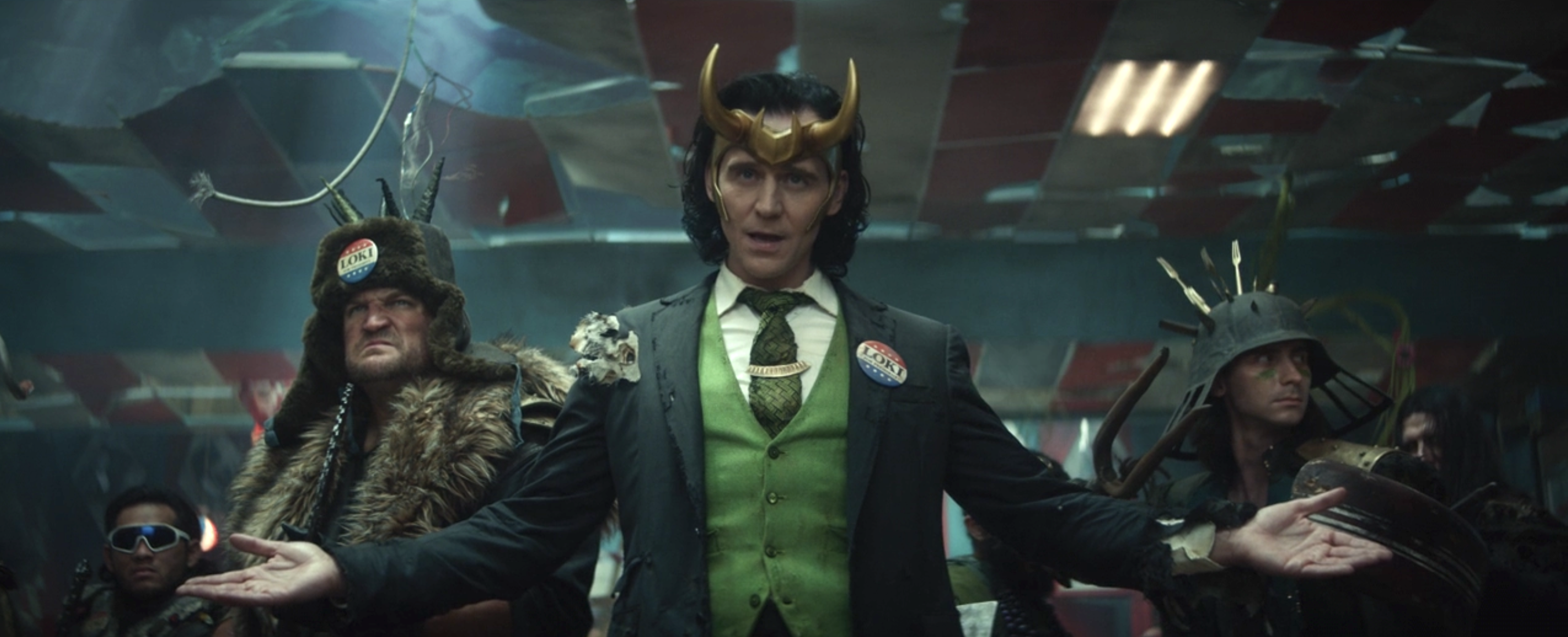 President Loki spreads his arms in front of his squad of Variant Lokis in Loki.