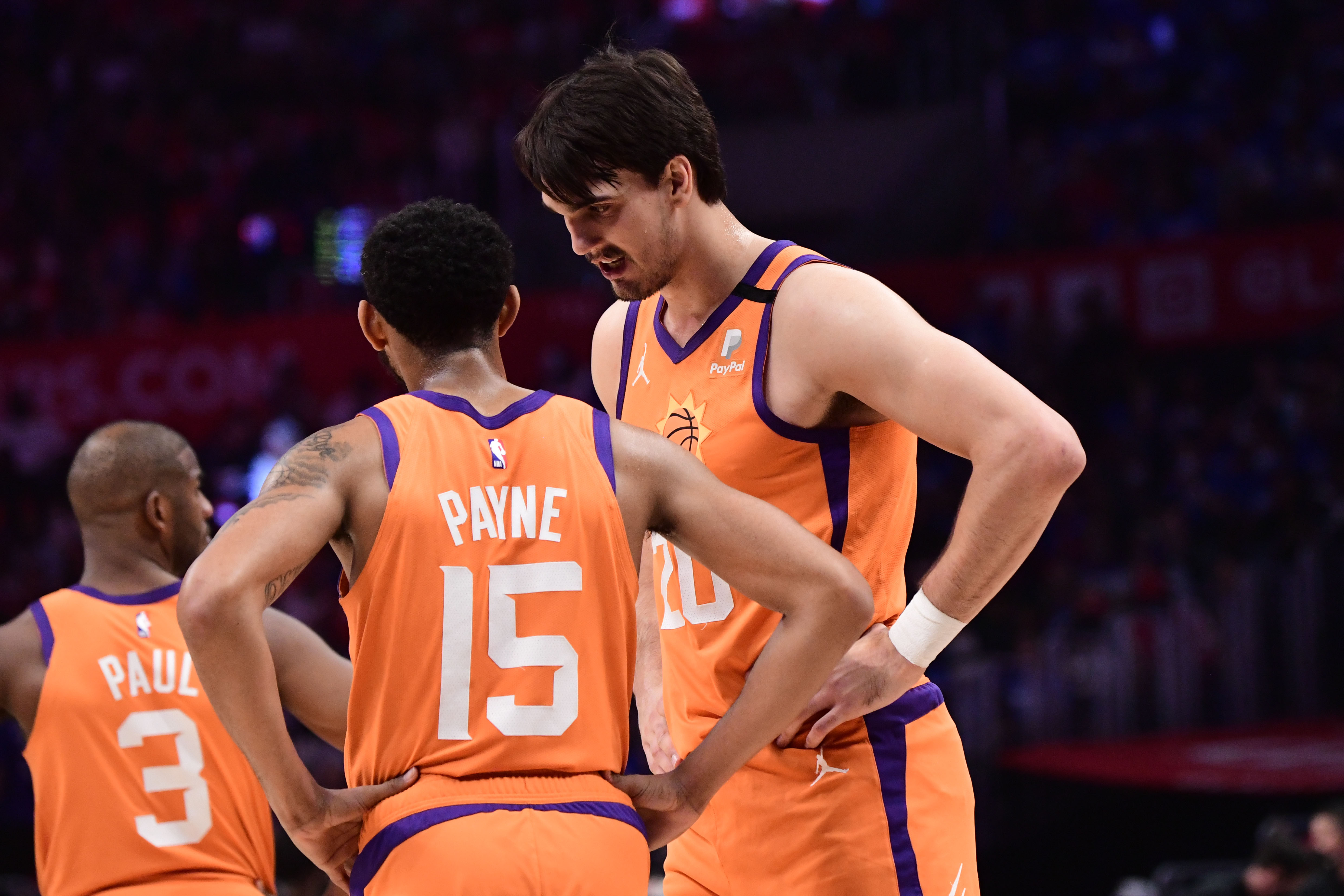 Dario Saric talks with Cameron Payne of the Phoenix Suns during Game 6 of the Western Conference Finals of the 2021 NBA Playoffs on June 30, 2021 at STAPLES Center in Los Angeles, California.