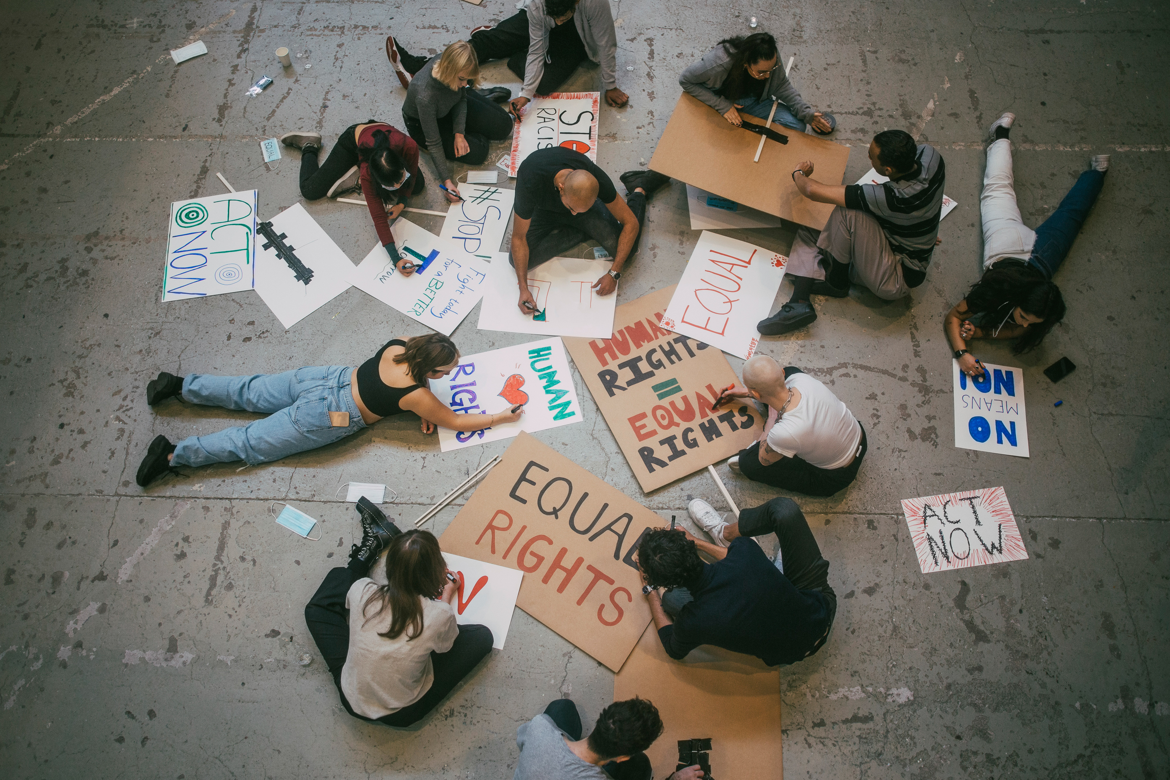 Young people make signs for equal rights and human rights.