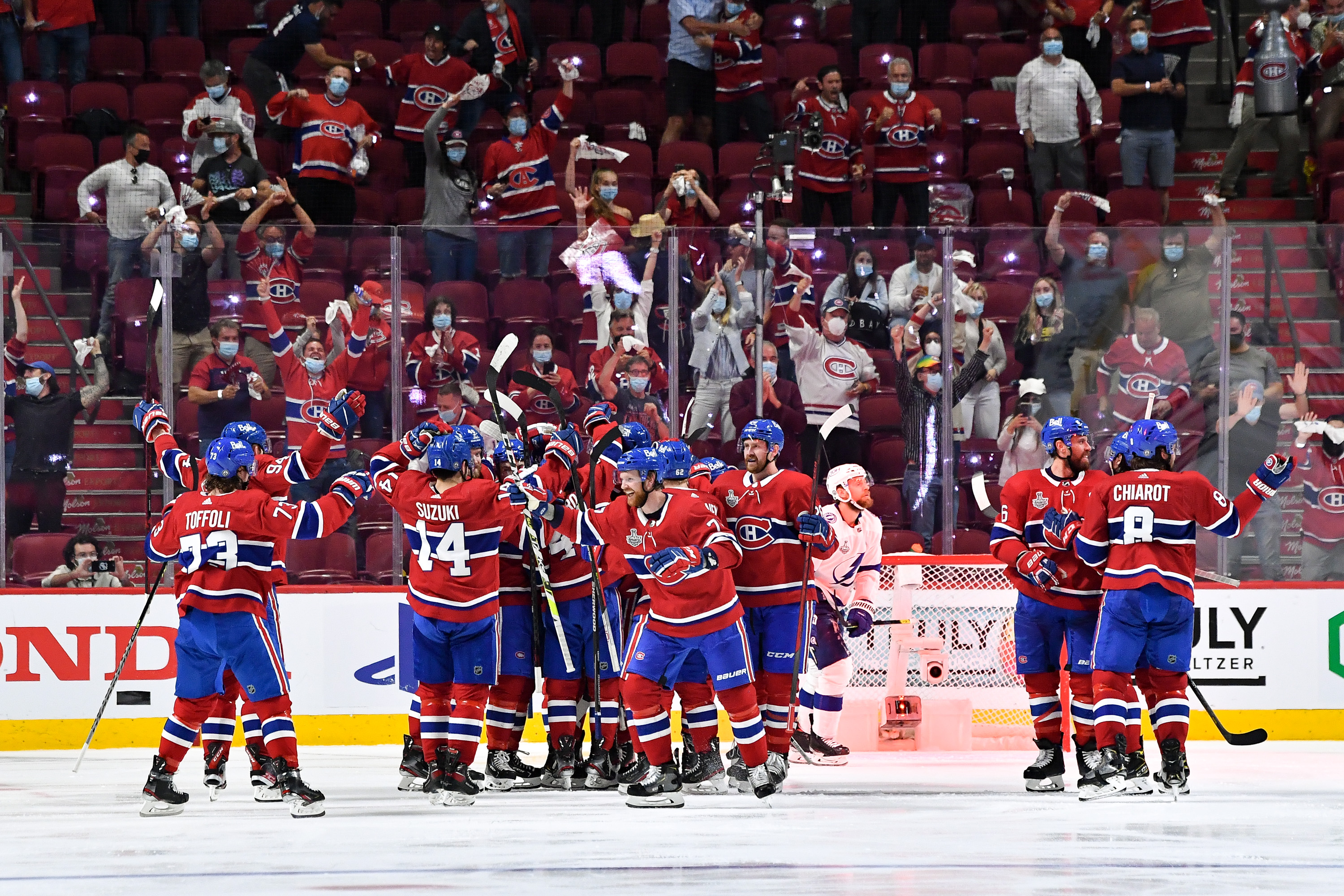 Montreal Canadiens celebrate after defeating the Tampa Bay Lightning in Game 4 of the Stanley Cup Final of the 2021 Stanley Cup Playoffs at the Bell Centre on July 5, 2021 in Montreal, Quebec, Canada.