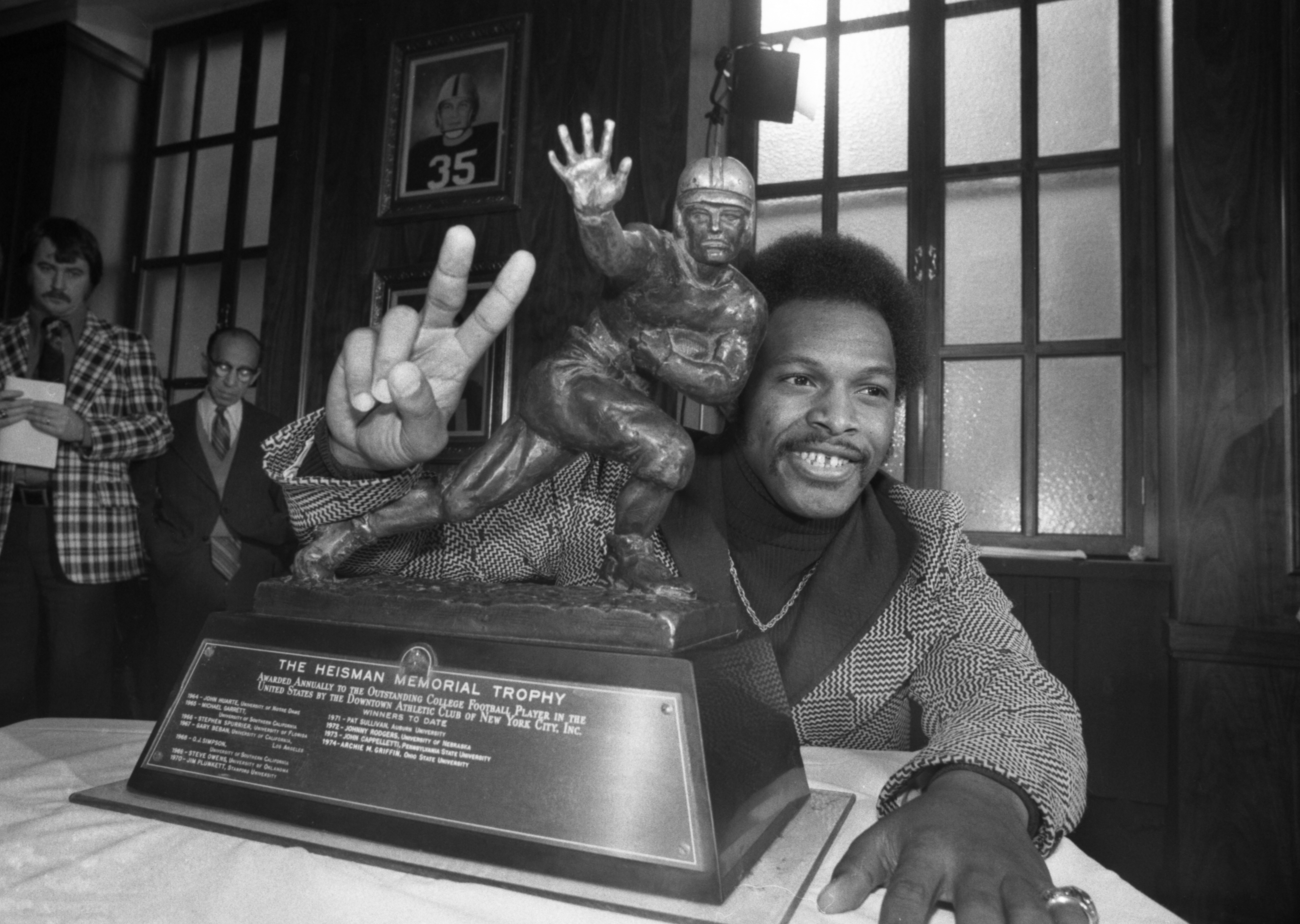 Archie Griffin Poses with the Heisman Trophy