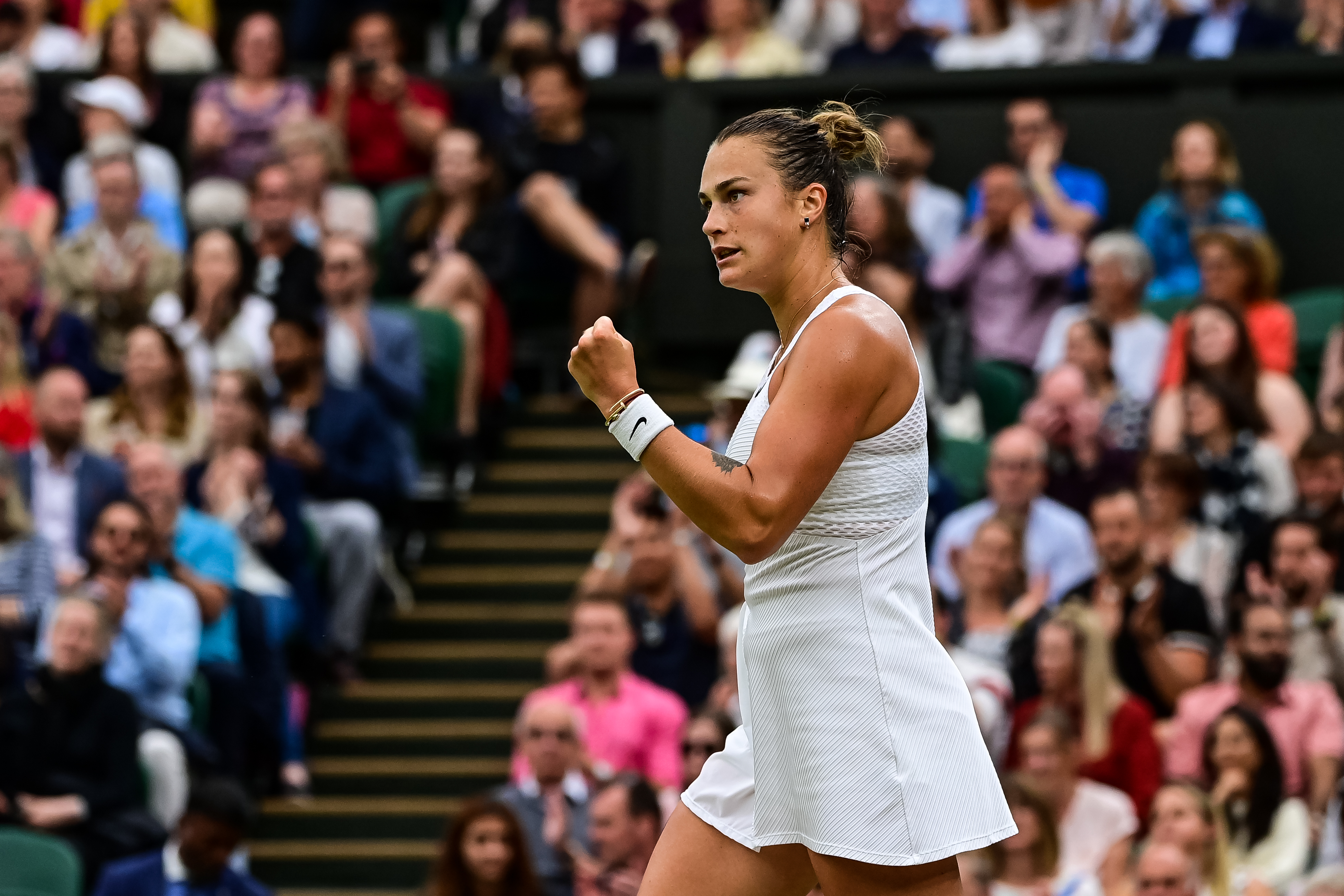 Aryna Sabalenka of Belarus celebrates during her match against Ons Jabeur of Tunisia in the quarter finals of the ladies singles during Day Eight of The Championships - Wimbledon 2021 at All England Lawn Tennis and Croquet Club on July 06, 2021 in London, England.