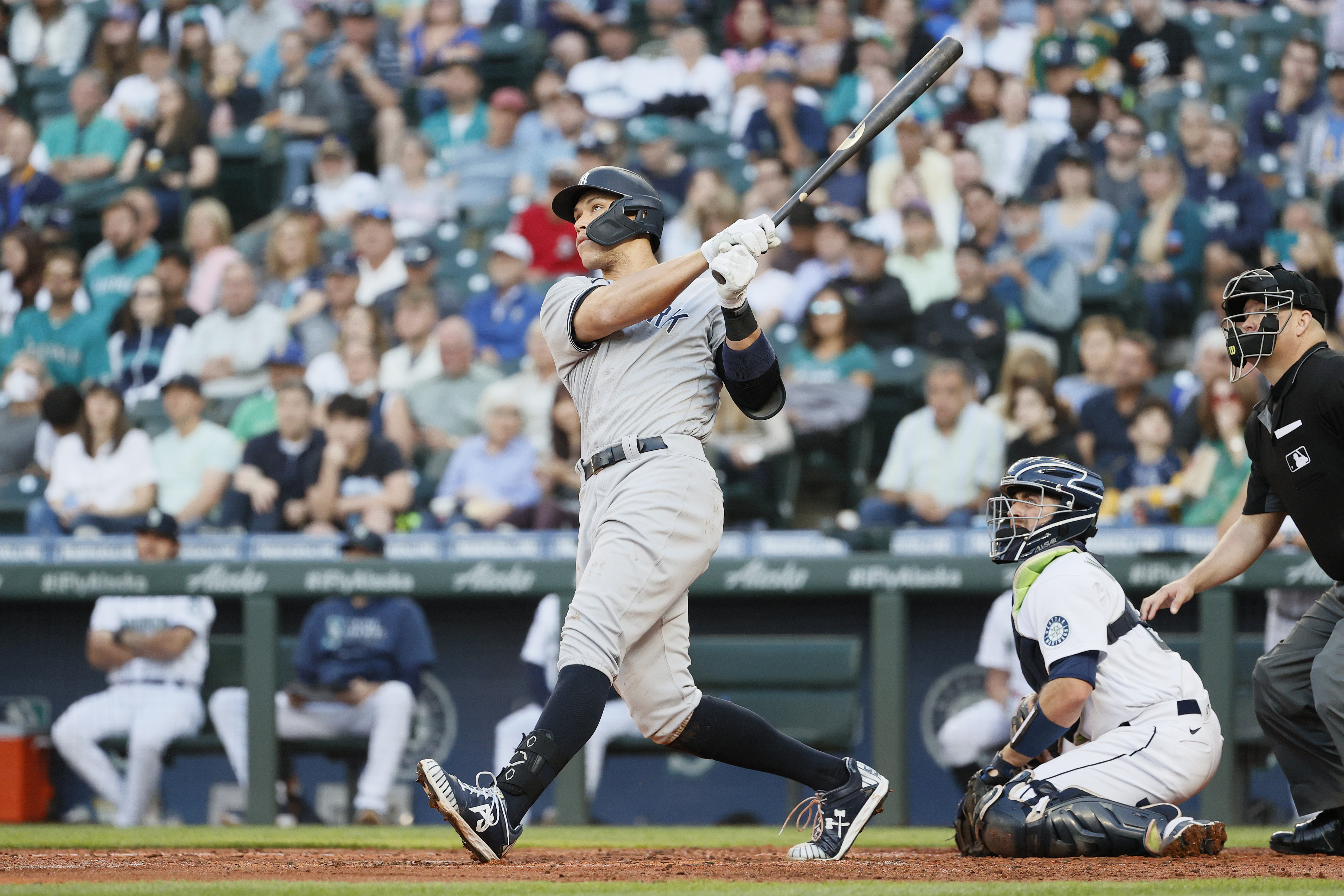 Aaron Judge #99 of the New York Yankees watches his two-run home run against the Seattle Mariners during the second inning at T-Mobile Park on July 07, 2021 in Seattle, Washington.