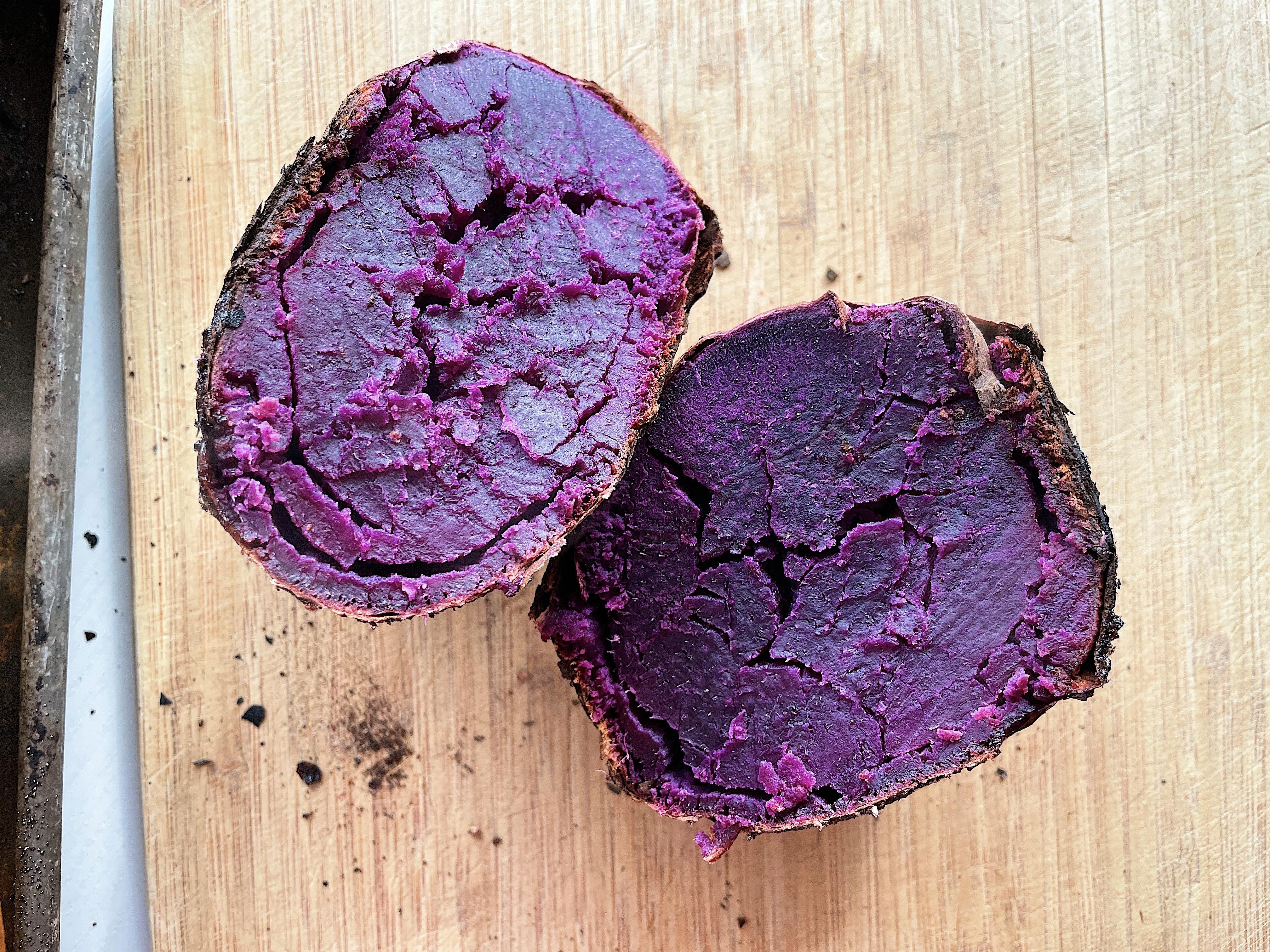 A purple frozen baked sweet potato, split in half