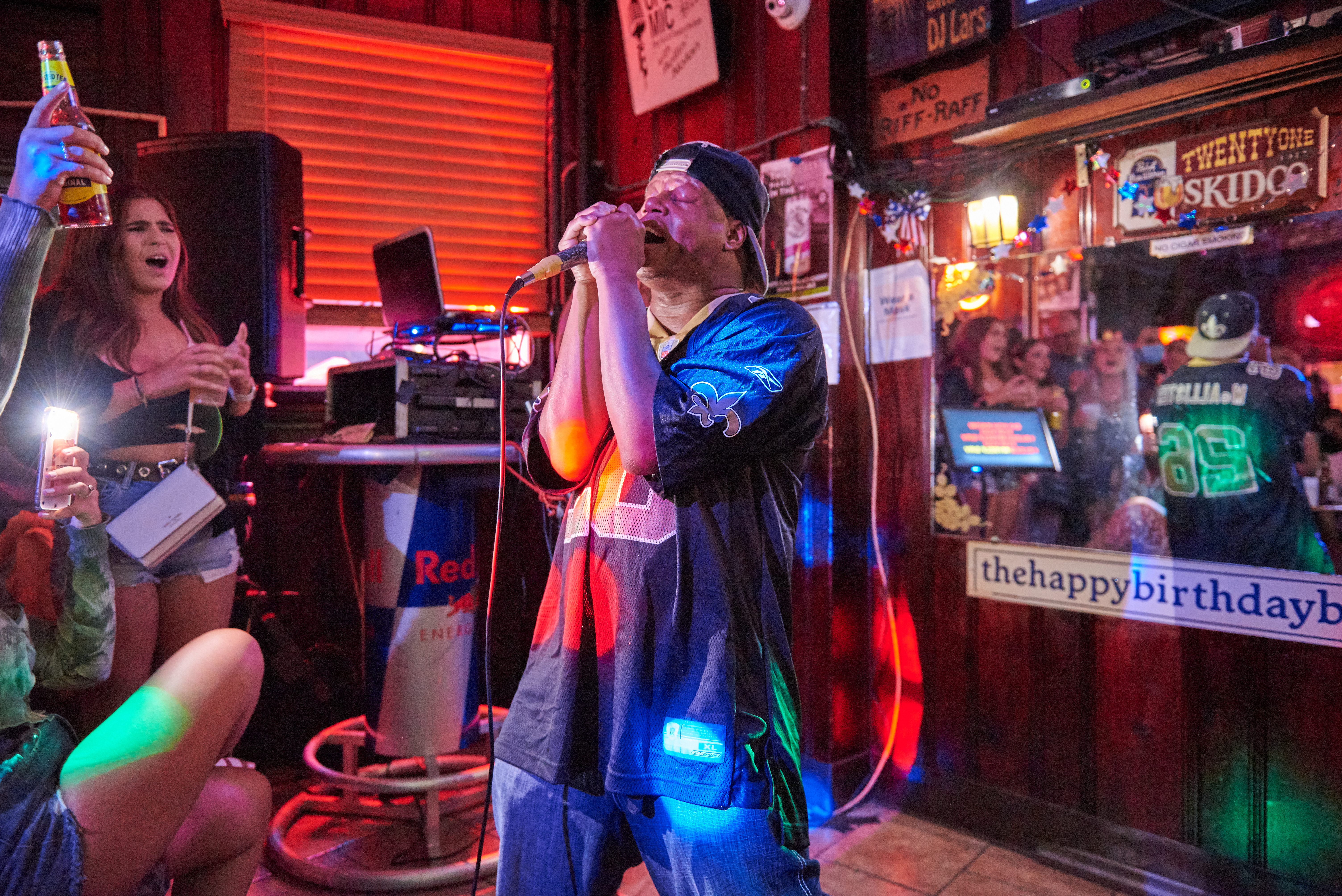 """Metal Steve sings Coldplay's """"Yellow"""" at Ray's Happy Birthday Bar Friday Karaoke with DJ Lars as a crowd of people sing along"""