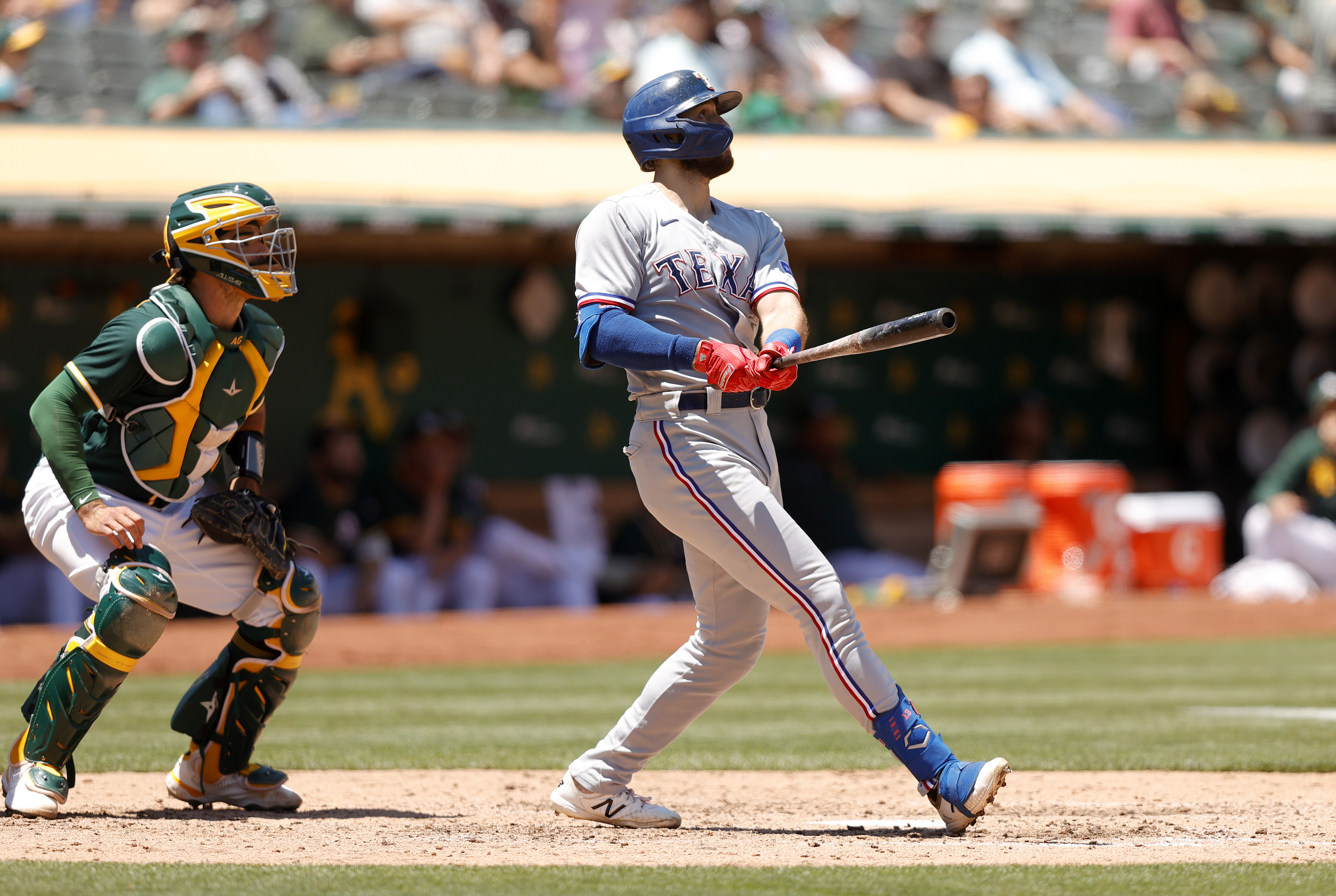 Joey Gallo #13 of the Texas Rangers hits a two-run home run in the fifth inning against the Oakland Athletics at RingCentral Coliseum on July 01, 2021 in Oakland, California.