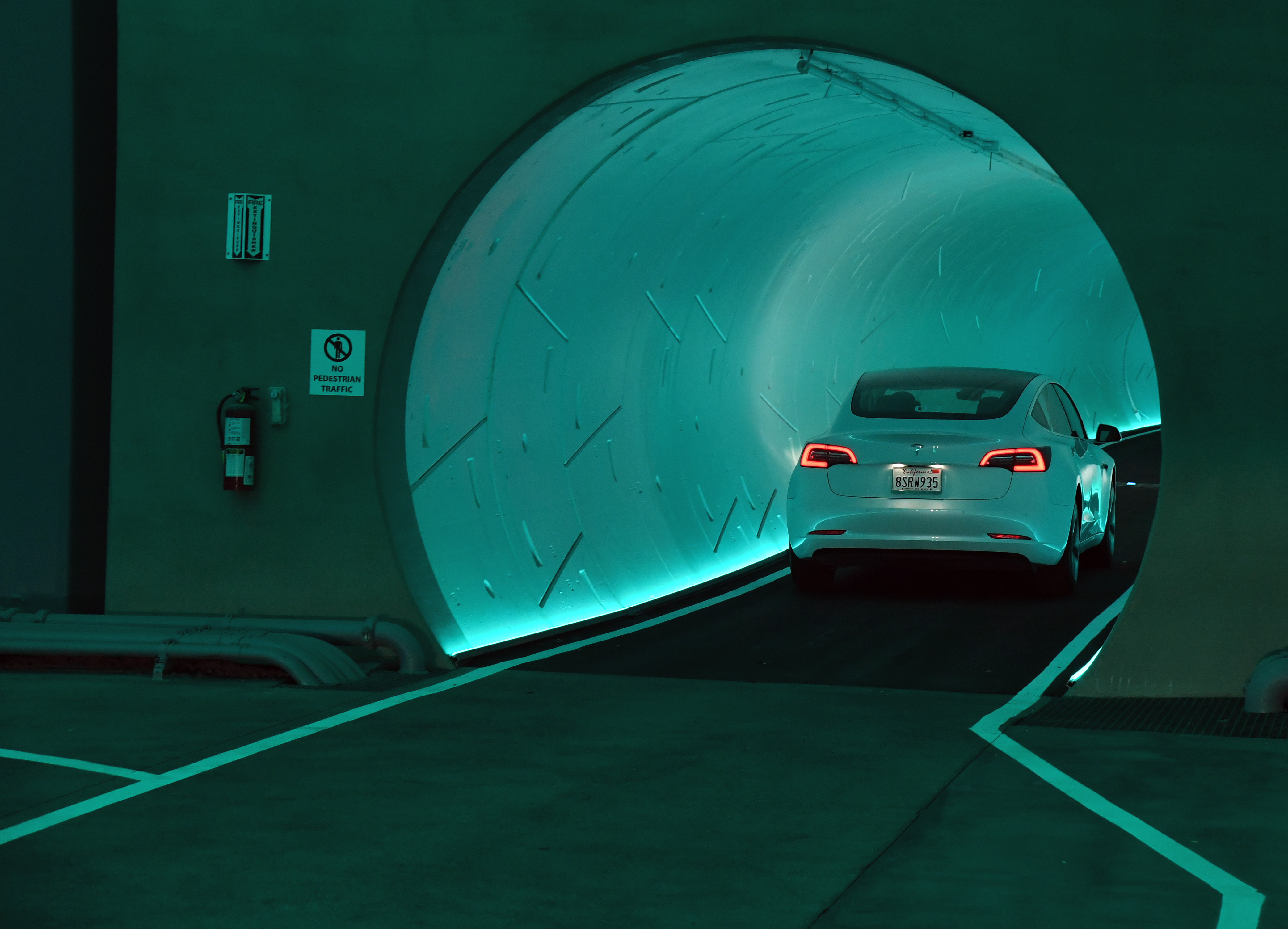 A car driving into a tunnel.