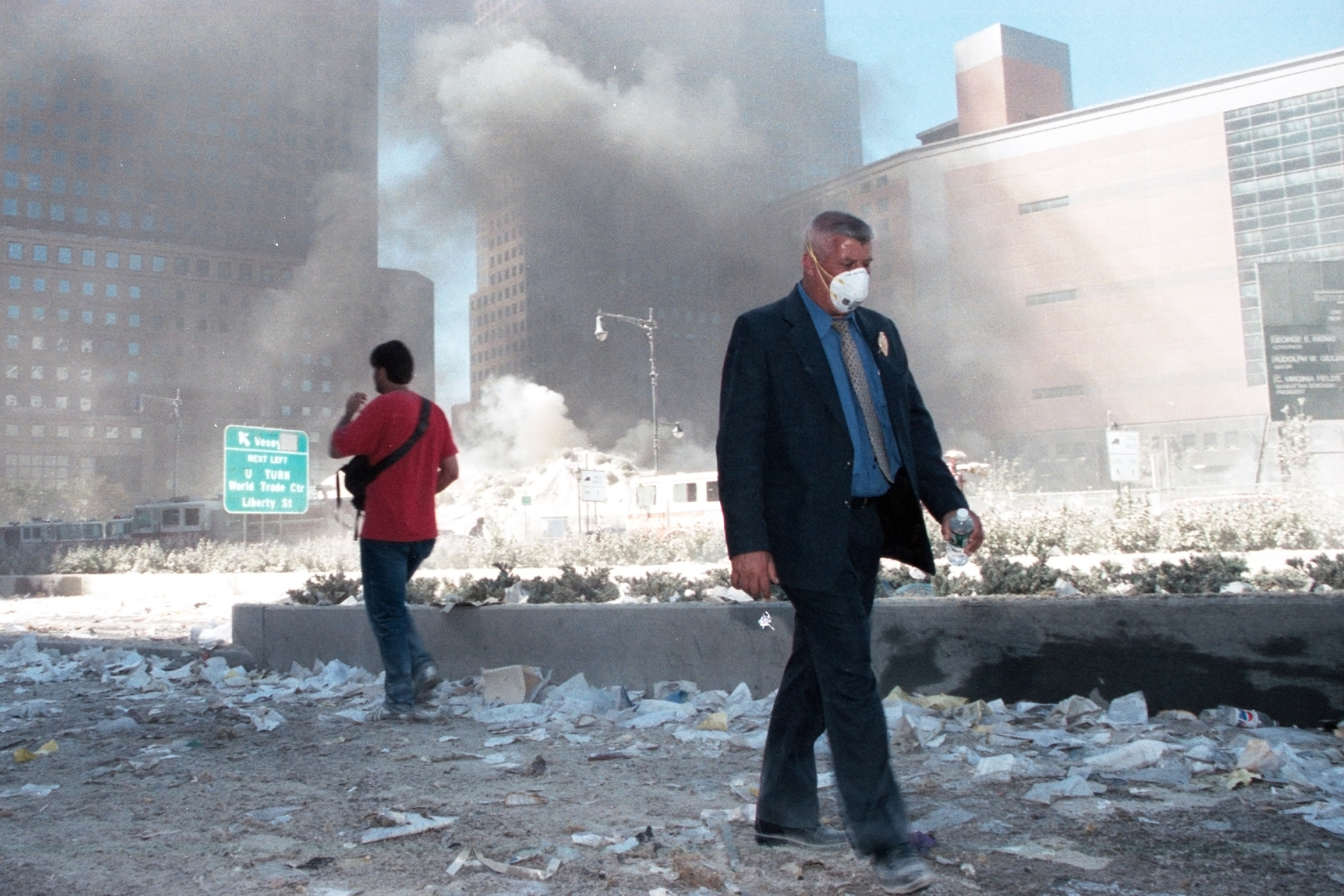 People walk around Ground Zero after the collapse of the Twin Towers on Sept. 11, 2001.