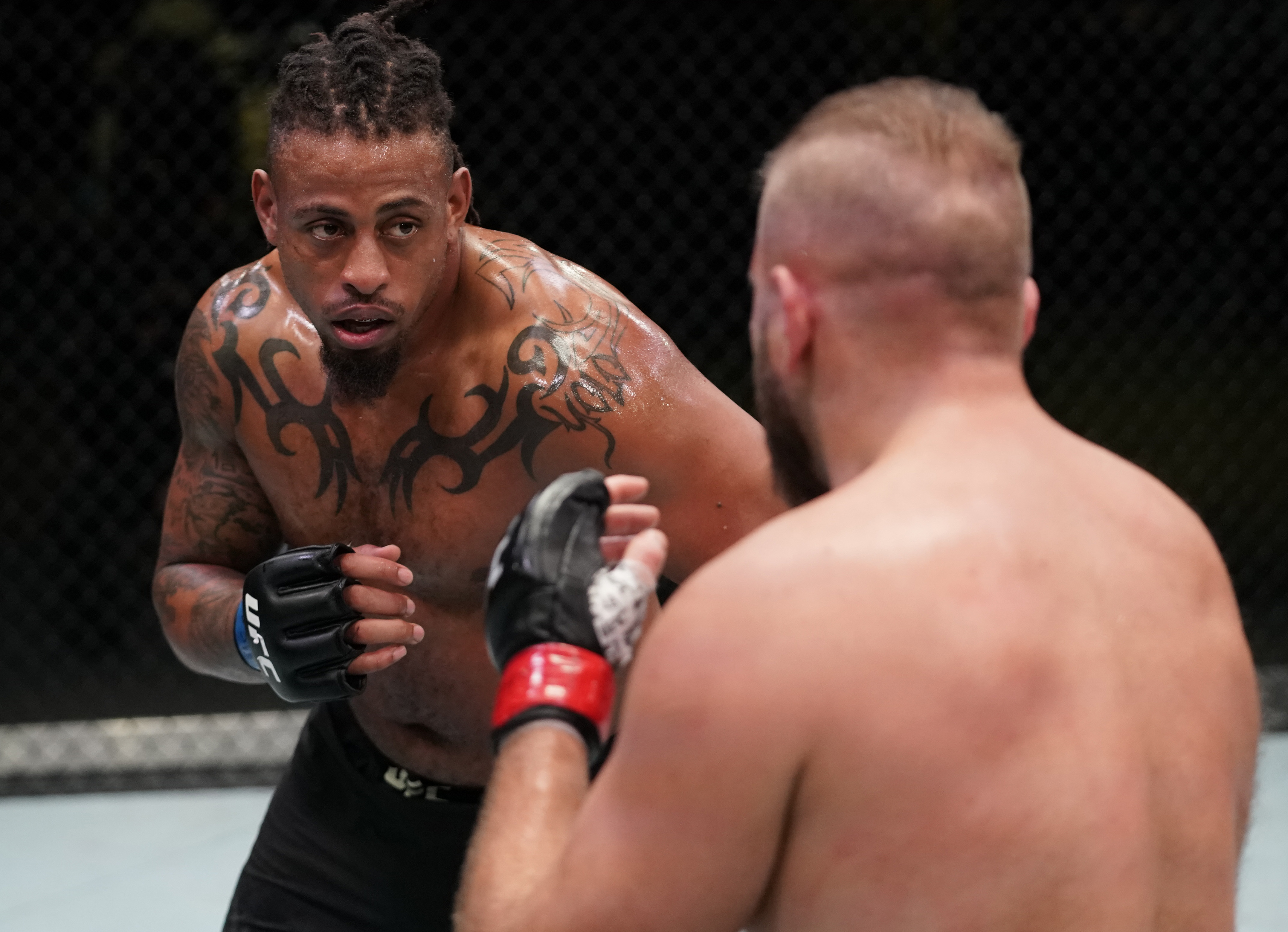 Greg Hardy battles Marcin Tybura of Poland in a heavyweight fight during the UFC Fight Night event at UFC APEX on December 19, 2020 in Las Vegas, Nevada.