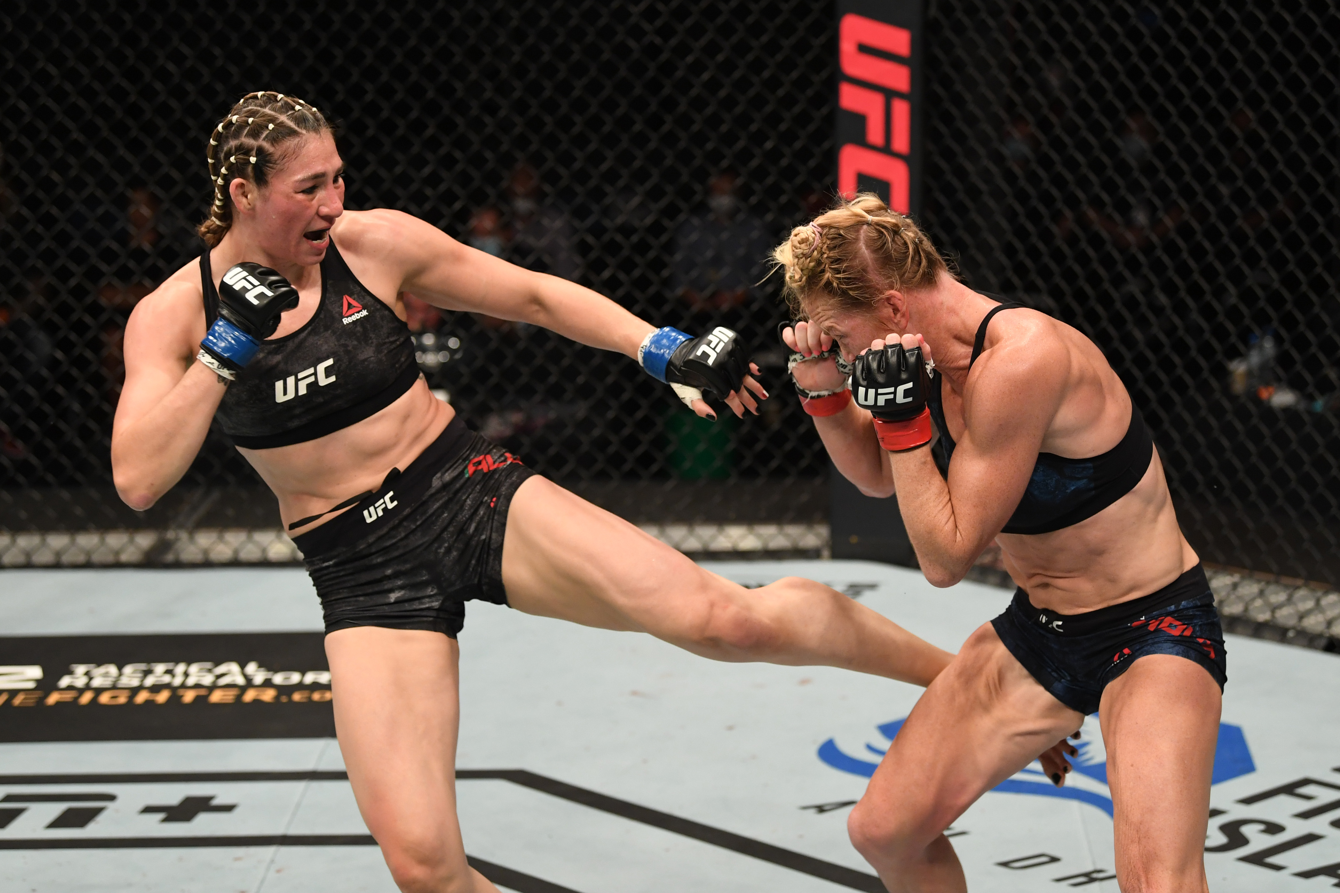 Irene Aldana of Mexico kicks Holly Holm in their women's bantamweight bout during the UFC Fight Night event inside Flash Forum on UFC Fight Island on October 04, 2020 in Abu Dhabi, United Arab Emirates.