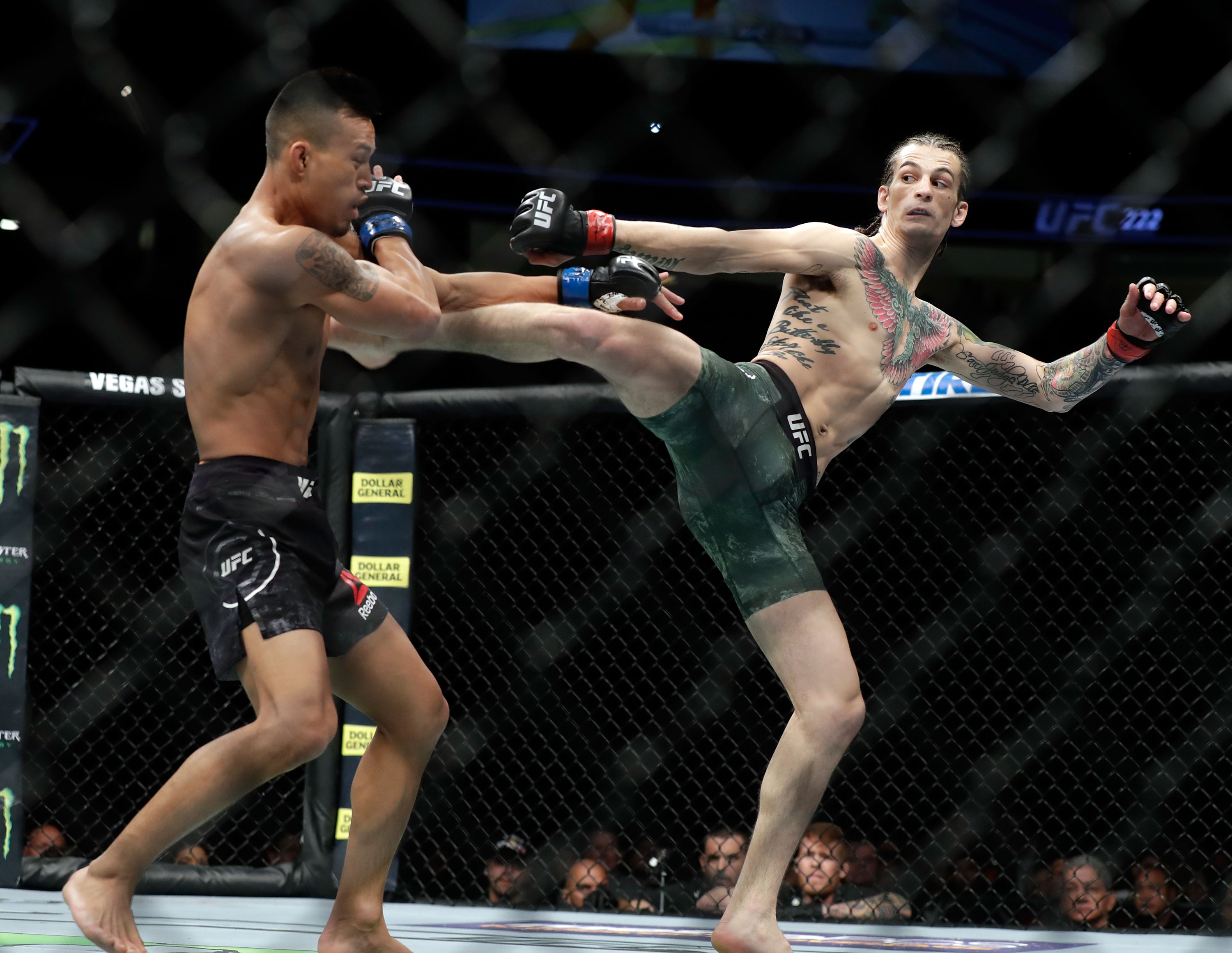 Sean O'Malley kicks Andre Soukhamthath during their bantamweight bout during UFC 222 at T-Mobile Arena on March 3, 2018 in Las Vegas, Nevada. O'Malley won by unanimous decision.
