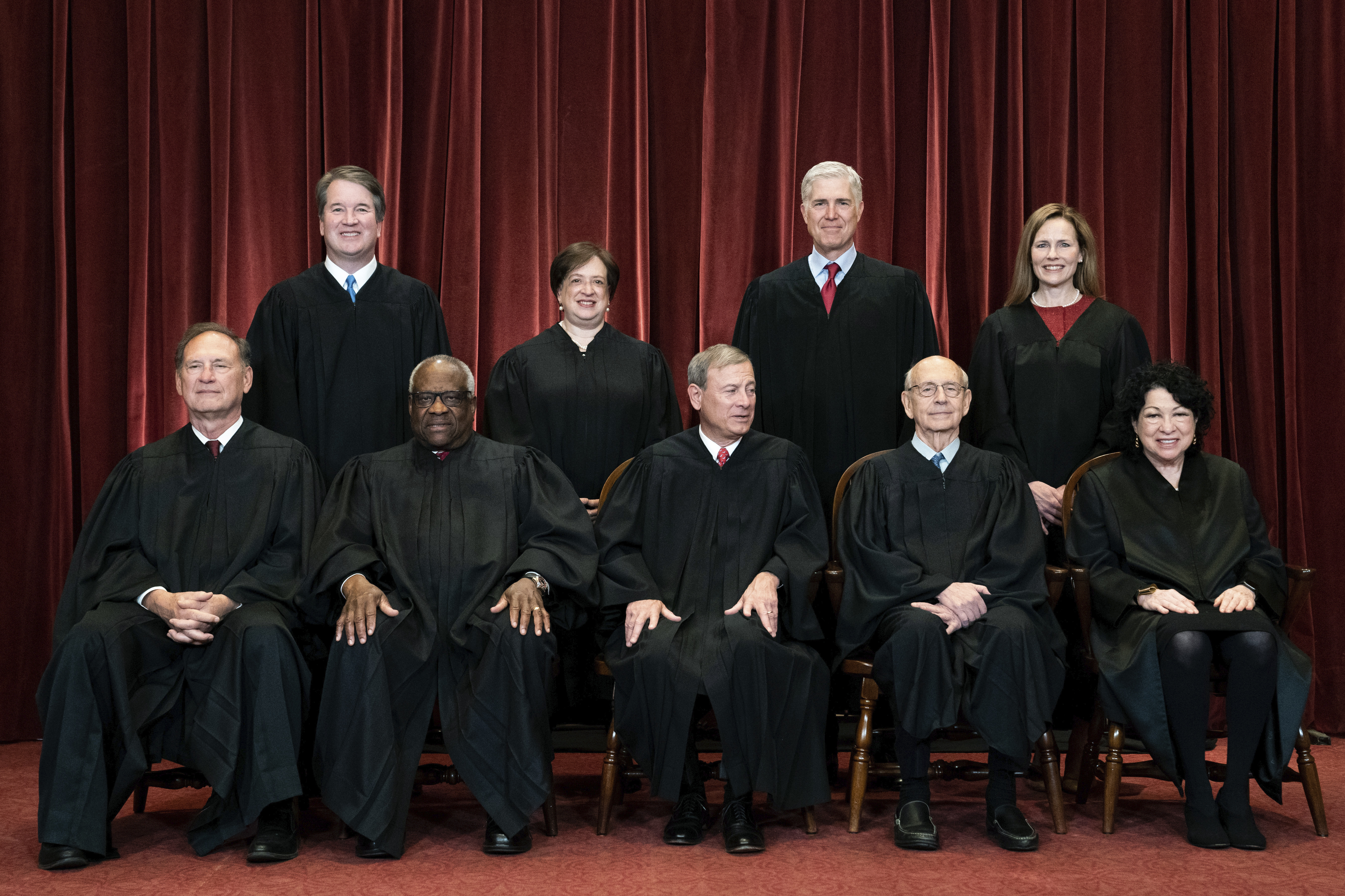 In this April 23, 2021, file photo, members of the Supreme Court pose for a group photo at the Supreme Court in Washington.