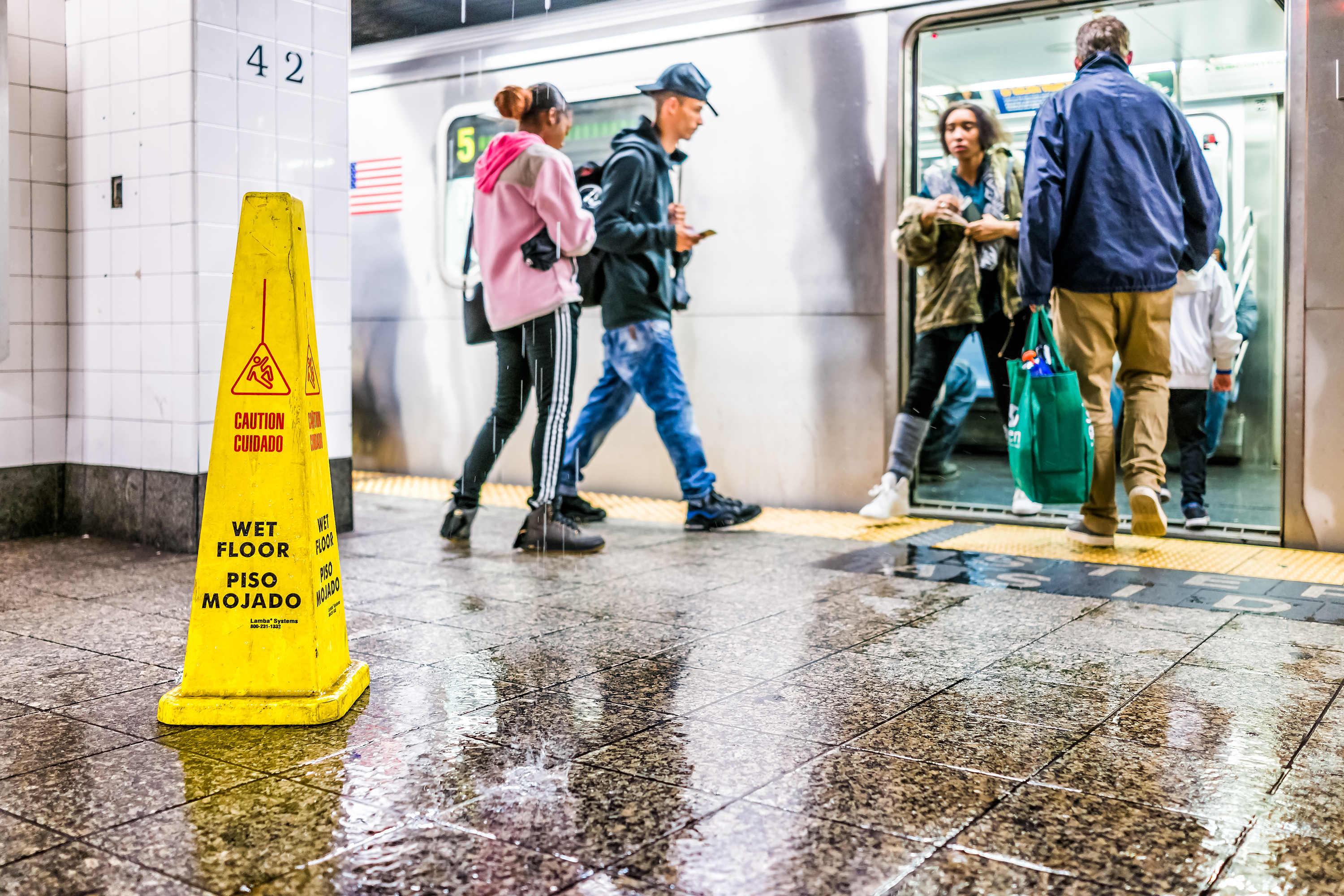 Water floods into the Grand Central subway platform in 2017.