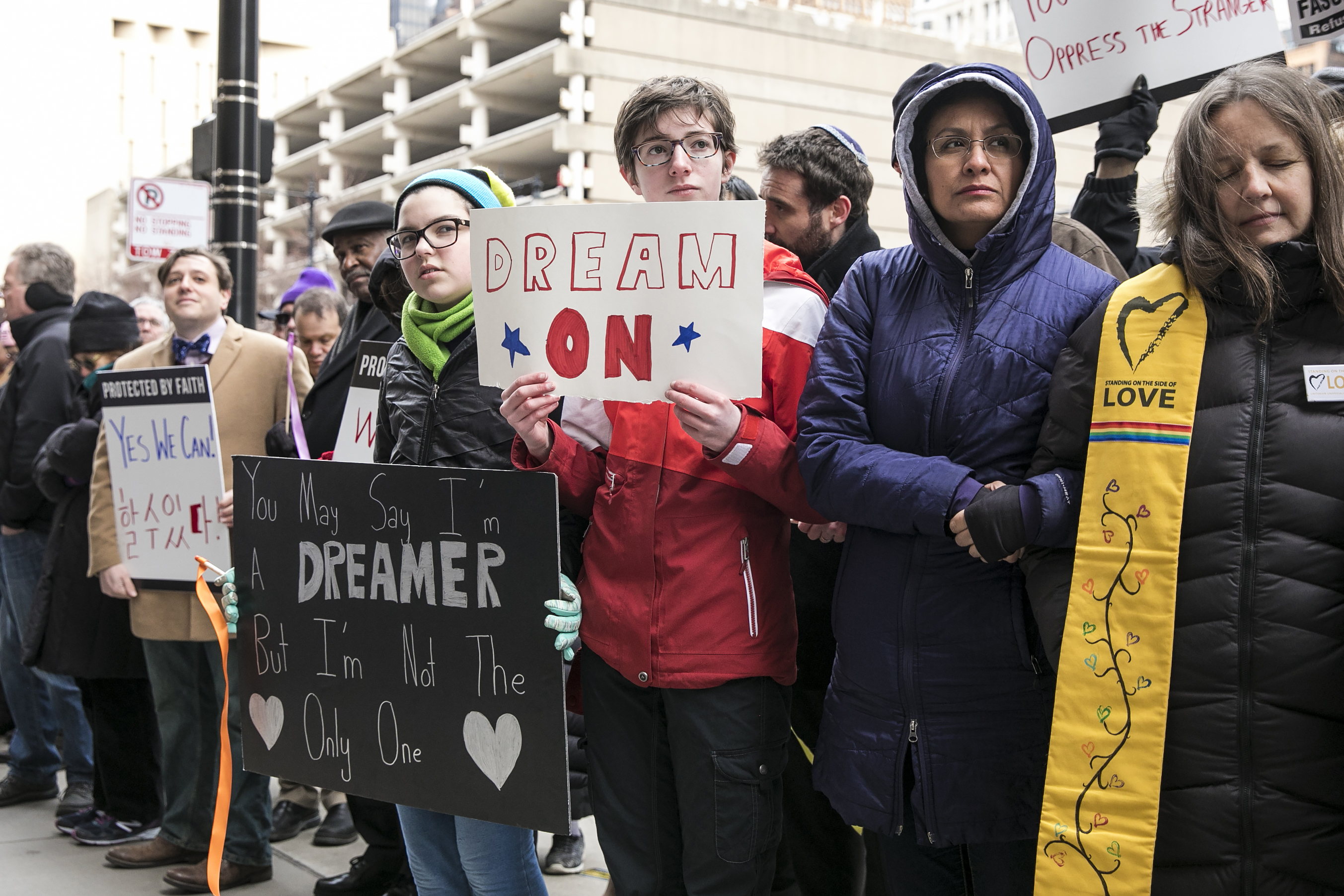 Activists and faith leaders link arms outside the Chicago headquarters of U.S. Immigration and Customs Enforcement to call for immigration reform in 2018.