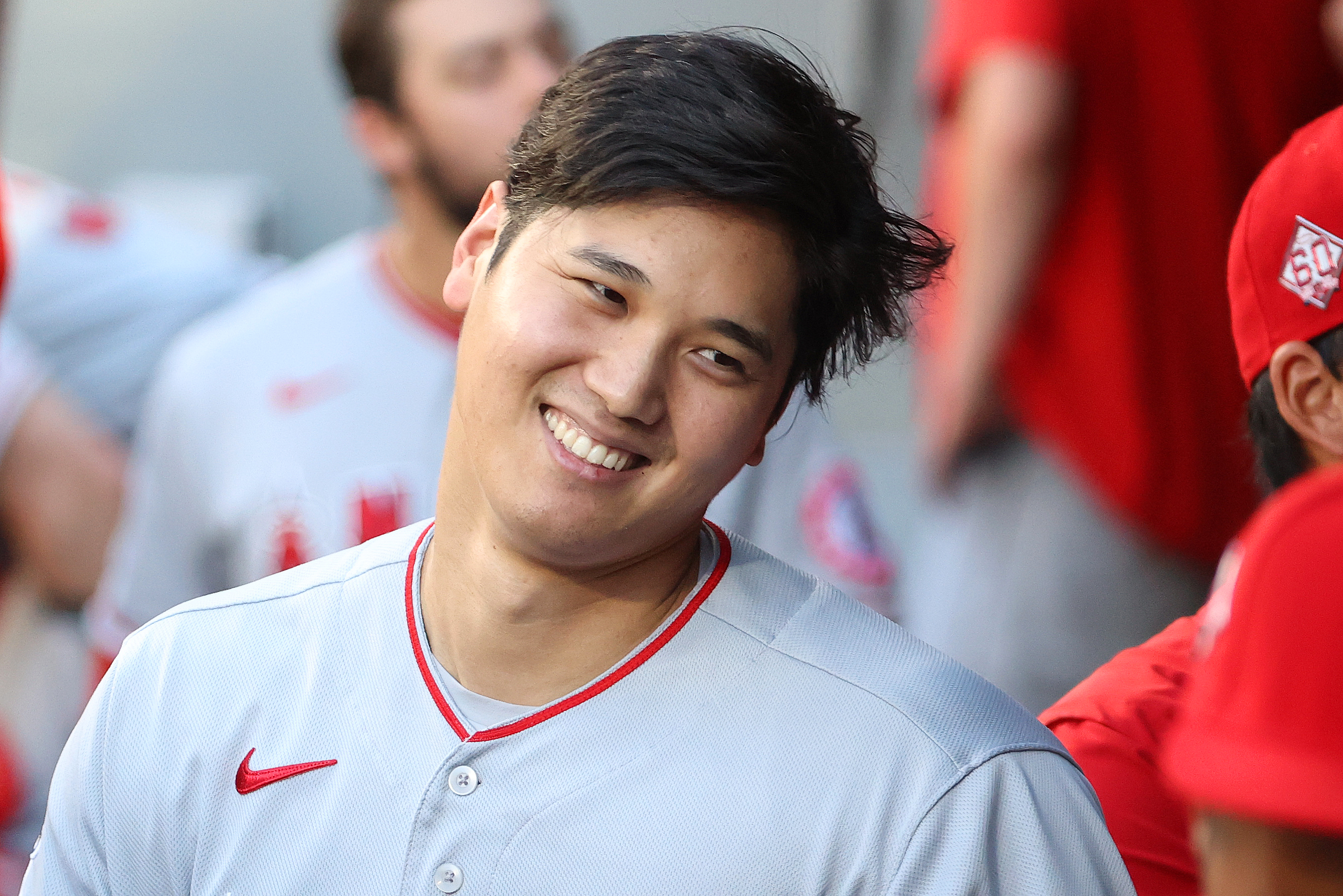 Shohei Ohtani #17 of the Los Angeles Angels celebrates in the dugout after hitting a solo home run during the third inning against the Seattle Mariners at T-Mobile Park on July 09, 2021 in Seattle, Washington.