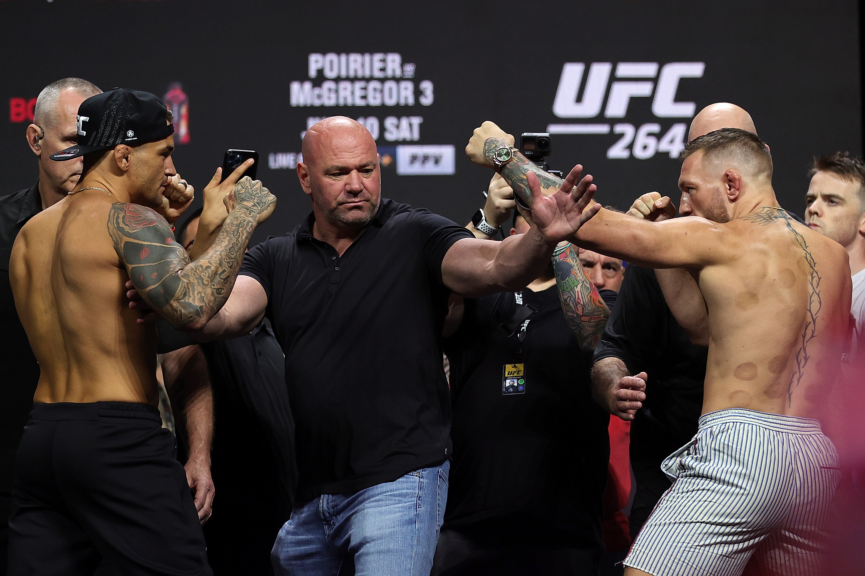 Dustin Poirier and Conor McGregor pose during a ceremonial weigh in for UFC 264 at T-Mobile Arena on July 09, 2021 in Las Vegas, Nevada.
