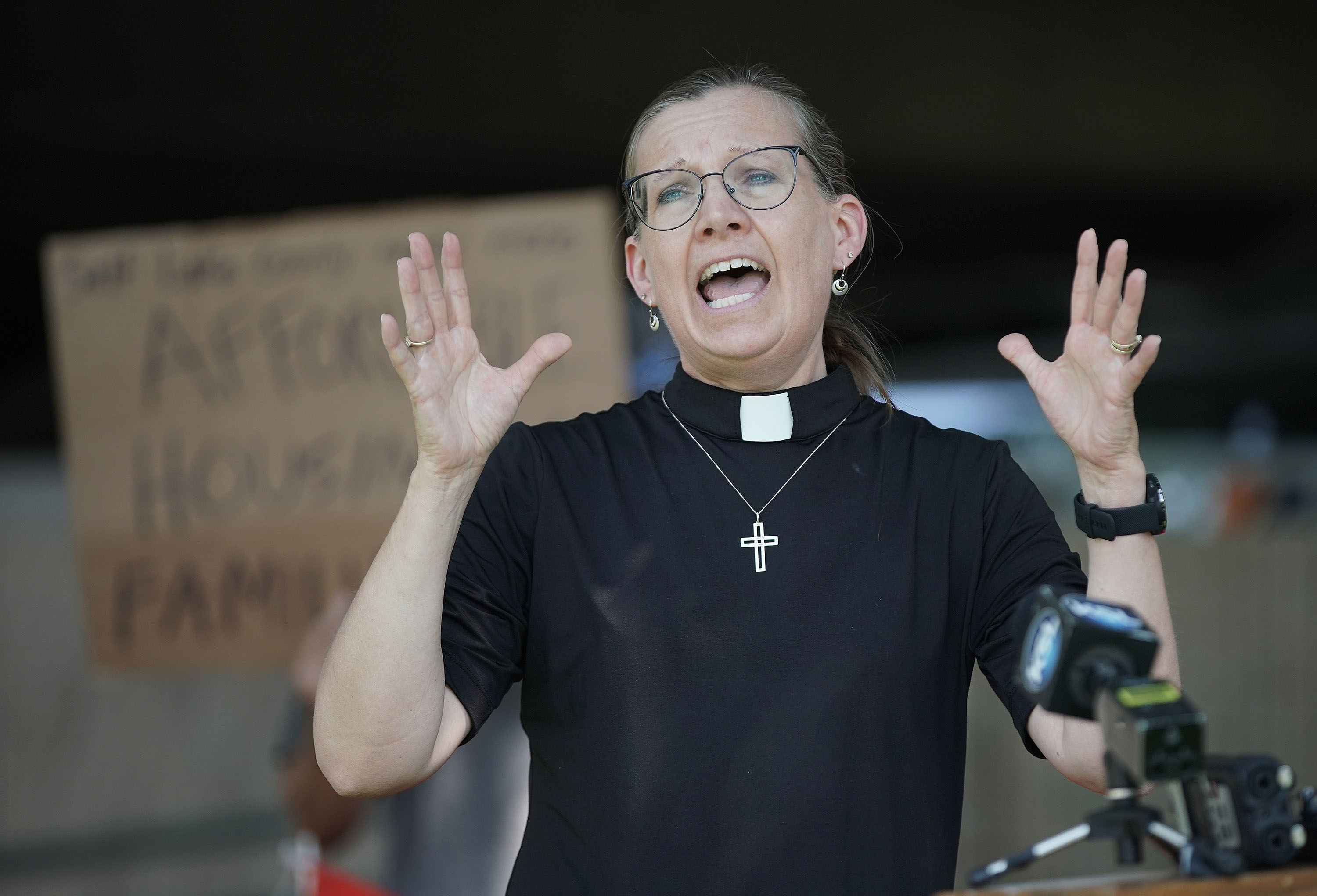 The Rev. Brigette Weier, of Our Saviour's Lutheran Church, speaks as faith leaders urge Salt Lake County government officials to use federal funds for housing to reduce homelessness for families, people with disabilities and senior citizens in Salt Lake City on Thursday, July 8, 2021.