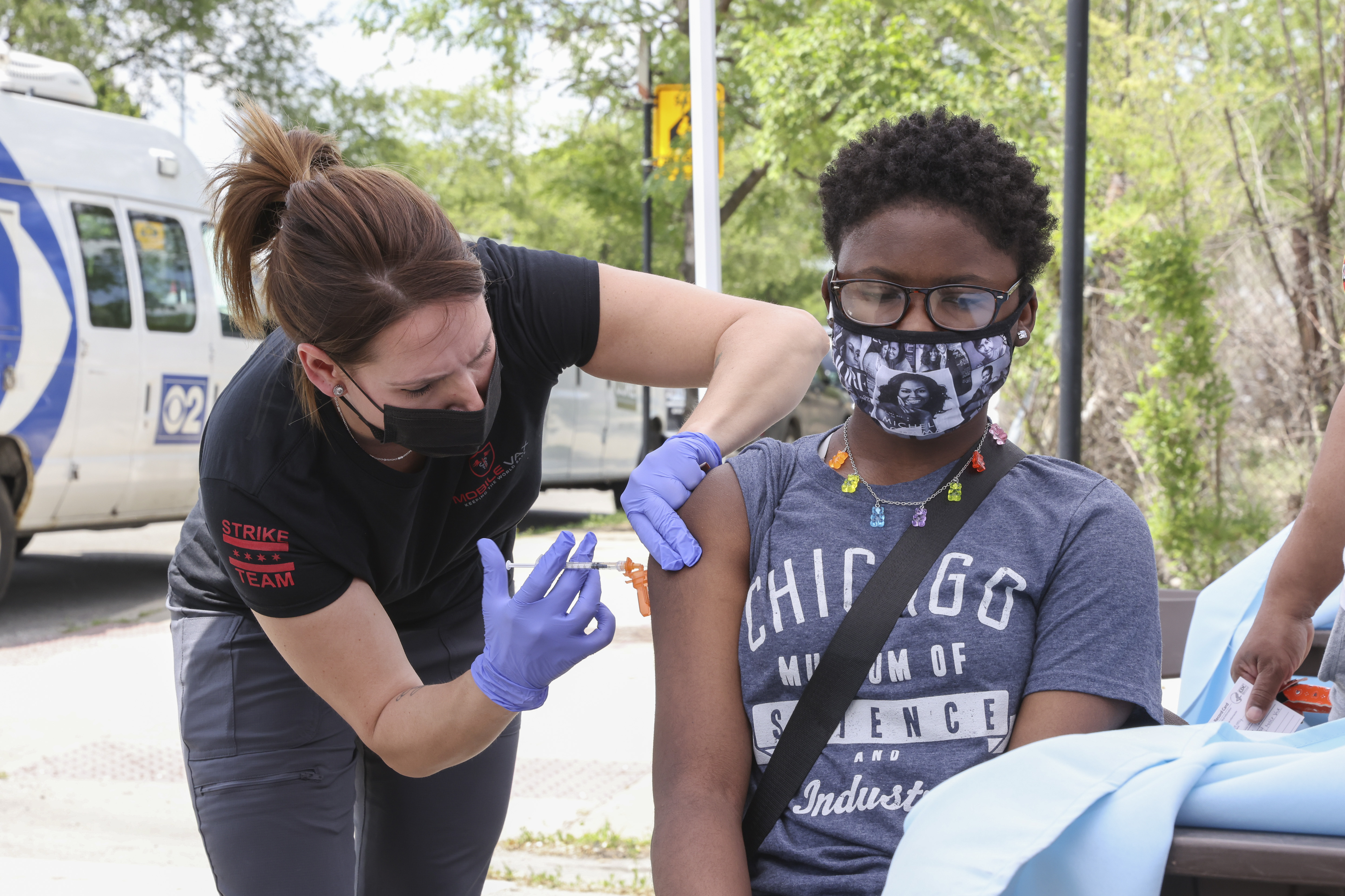 """Odamay Boone, 12, gets a vaccine at a Chicago of Public Health event at a """"Vax and Relax"""" event at 1256 W 63rd St in Englewood, Saturday, June 5, 2021."""