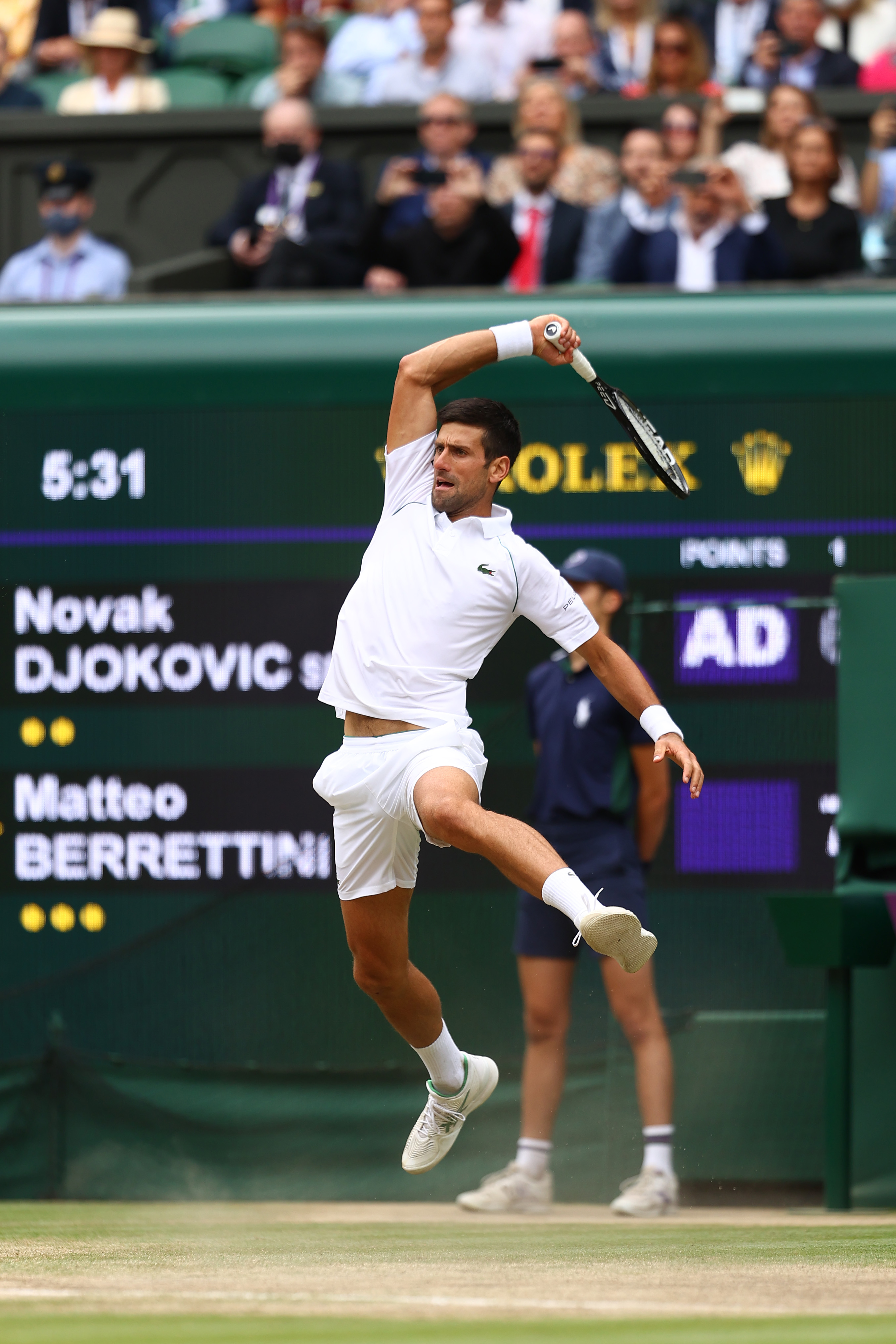 Novak Djokovic of Serbia plays a forehand during his men's Singles Final match against Matteo Berrettini of Italy on Day Thirteen of The Championships - Wimbledon 2021 at All England Lawn Tennis and Croquet Club on July 11, 2021 in London, England.