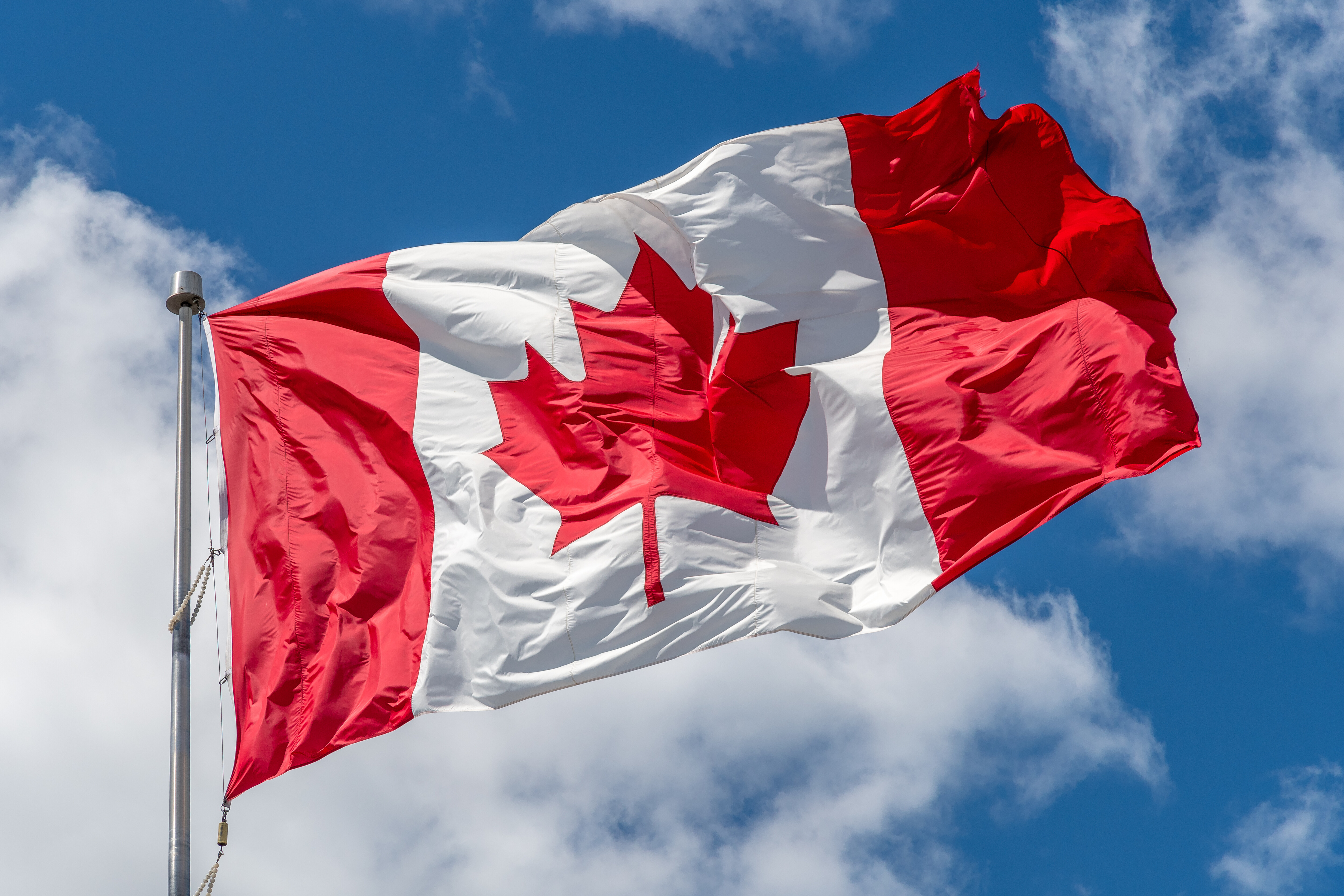 Canadian National flag waving on a clear sunny day...