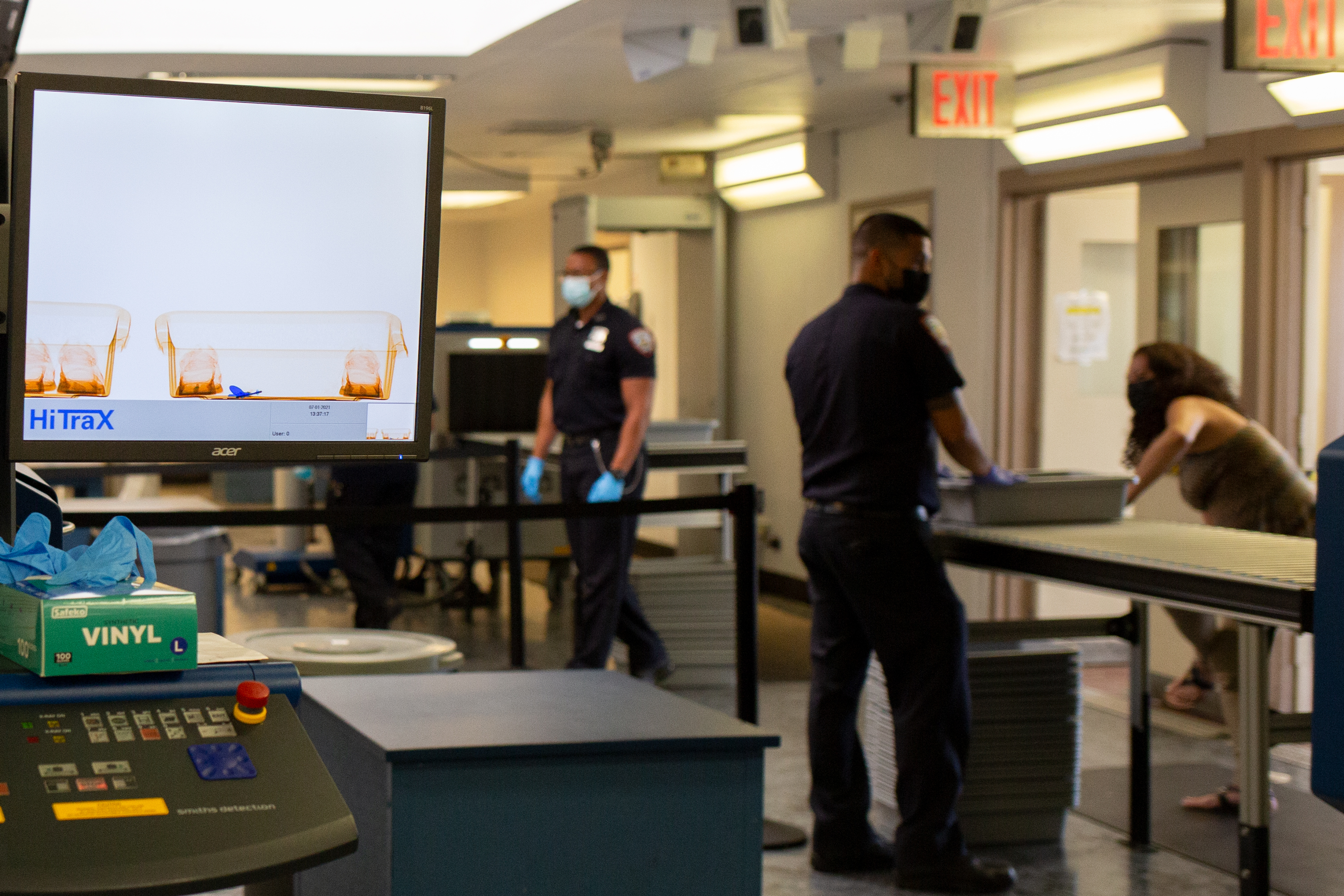 Department of Correction officers screen visitors on Rikers Island, July 1, 2021.