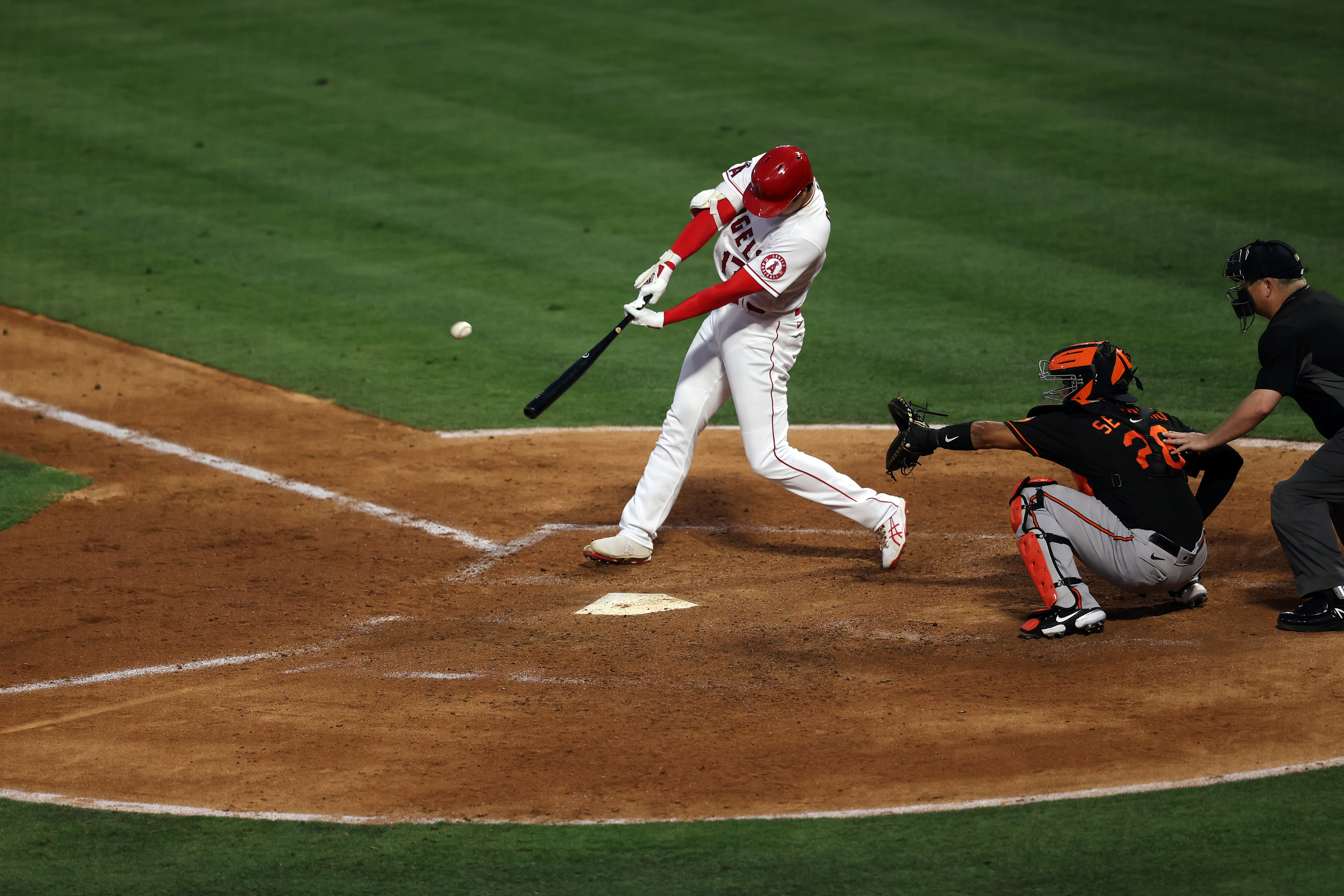 Shohei Ohtani #17 of the Los Angeles Angels hits a homerun against the Baltimore Orioles in the fourth inning at Angel Stadium of Anaheim on July 02, 2021 in Anaheim, California.
