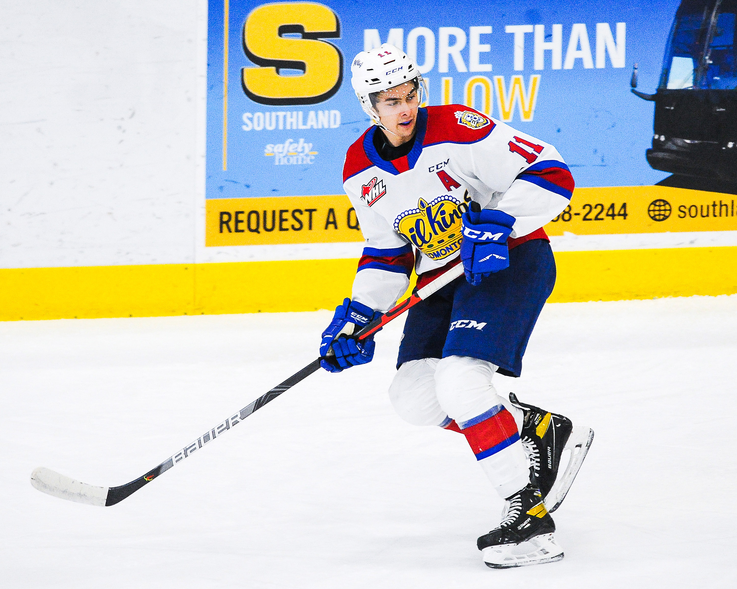 Dylan Guenther #11 of the Edmonton Oil Kings in action against the Calgary Hitmen during a WHL game at Seven Chiefs Sportsplex on March 27, 2021 in Calgary, Alberta, Canada.